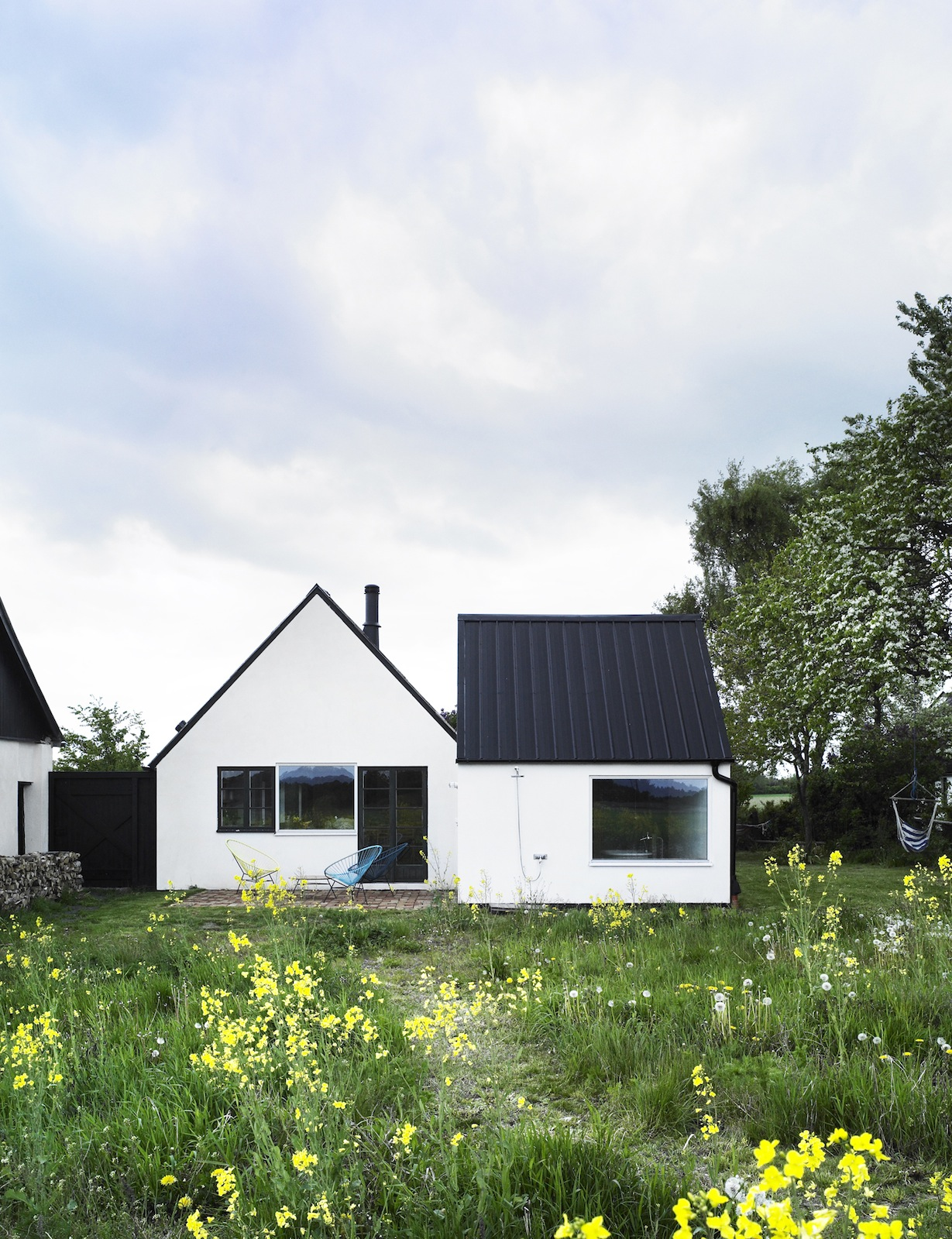 "Set in the Swedish summer retreat area of Österlen, this conversion of an abandoned farmhouse re-­thinks and plays on the notion of ""nostalgia and shelter by combining them with very contemporary desires for space, light and nature,"" say the architects. P"