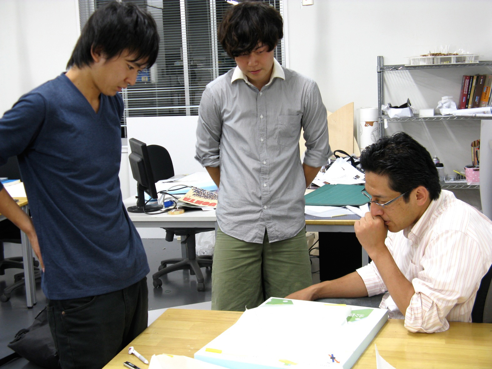 Yasuaki Onoda and his students at work on models for the reconstruction.