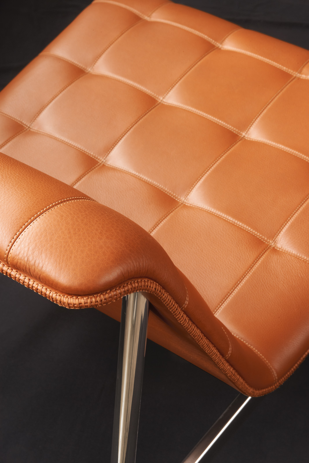 Brown leather chair by Charles Pollock