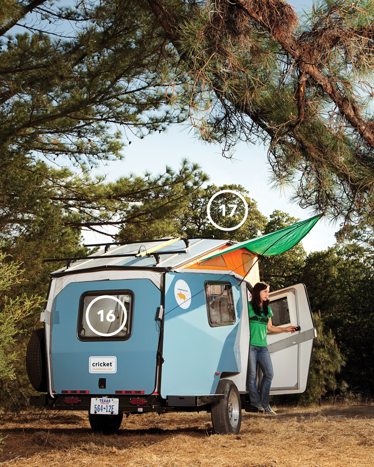 "Although Finney believes that when you're camping ""you're supposed to leave your house and its comforts at home,"" the Cricket's canopy (17) lends the trailer a homey feel while providing a triangle of shade. The back pops open to provide easy access to th"
