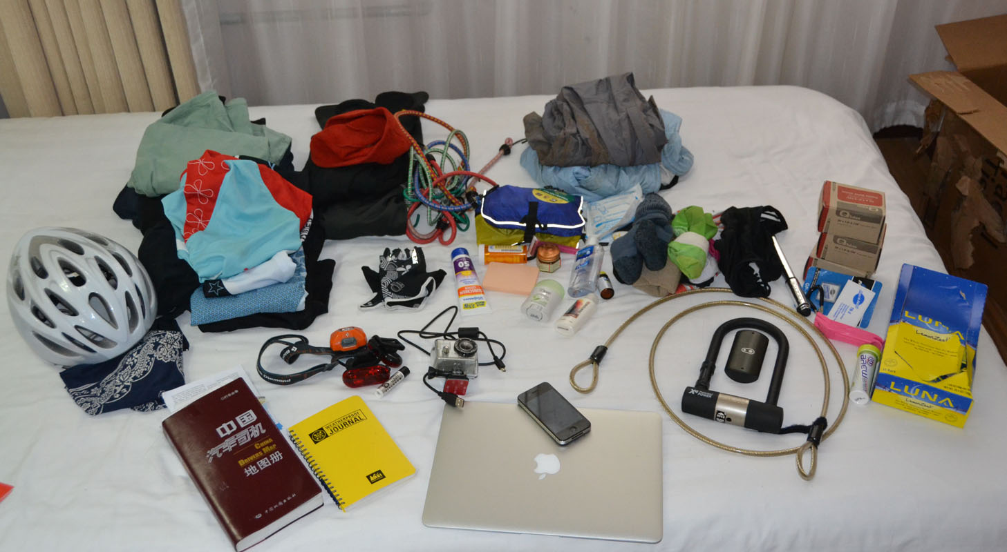 "Packing lightly was key, as everything Shahid brought with her has to be carried and stowed on her bike. Here's what's in her two panniers and handlebar bag, including three changes of clothes that she washes in her hotel sinks. ""I'm regretting the decisi"