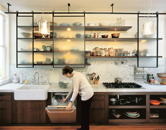 For this San Francisco kitchen remodel, designer Larissa Sand installed custom-built textured glass panels that roll on blackened steel tracks. The translucent finish and back lighting abstract the stored items, creating a clean composition (even when it'