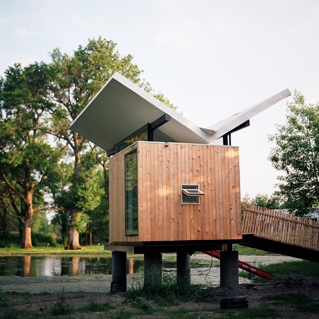 """Designed by architect <a href=""""http://www.jefferyspossarchitect.net/"""">Jeffery Poss</a>, the tea hut is the first of what Kalanzis and her husband, Bill Cope, hope to be several sculptural structures on their property, which comprises a forested grove to t"""