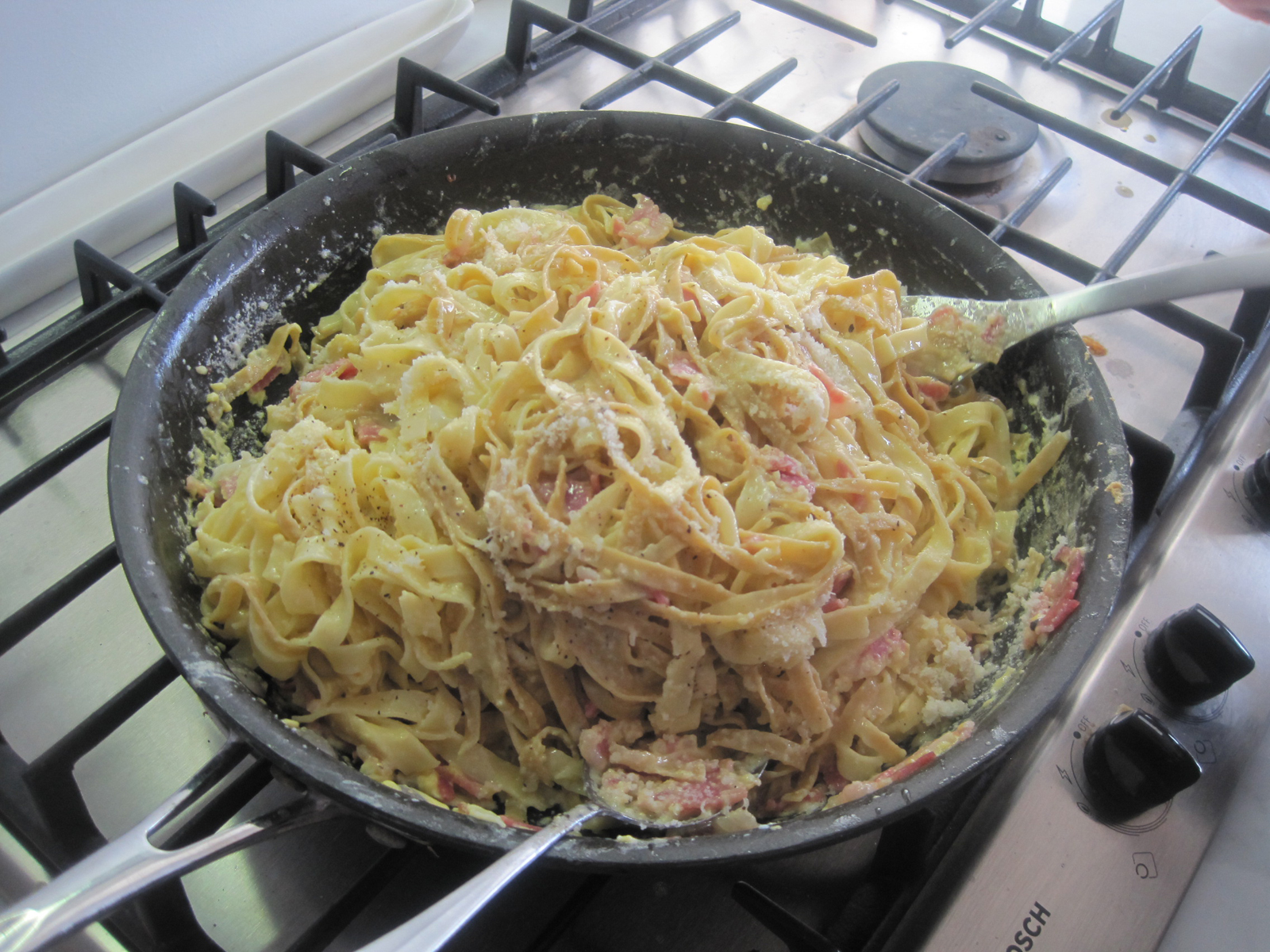 The eggs will coagulate as they come into contact with the hot pasta so it is important to work quickly.