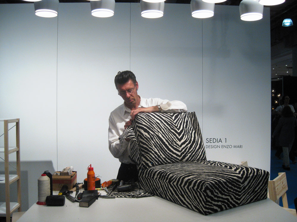 At the ICFF in New York, Aki Lehtonen, a veteran employee of Artek, puts the finishing touch on an Aalto Armchair 400.