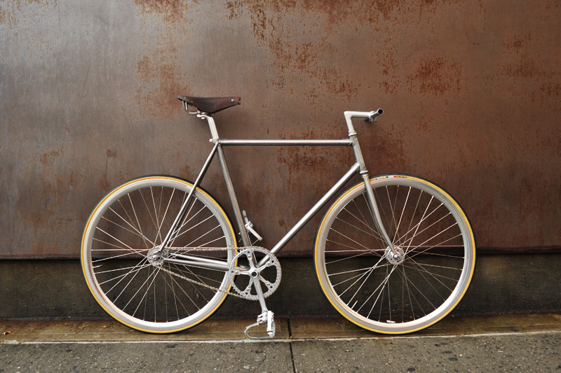 "From Bertelli's site: ""Hand brushed lugged steel. Deep rims on hig-flange hubs. Nitto bars and stem. Rare Ideale 87 leather saddle. The crankset is a vintage combo: Campagnolo Record cranks and Sugino Mighty chainring. To complete the setup we chose Velof"