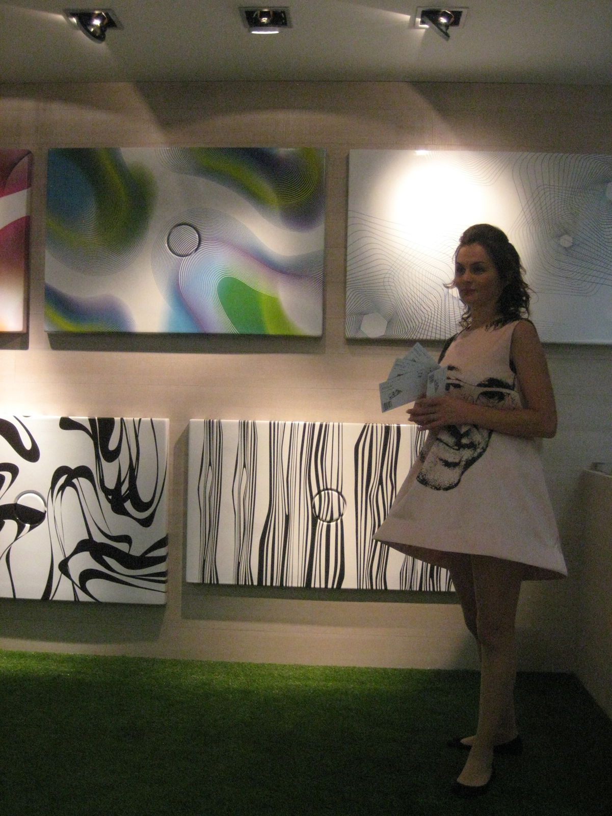 If you couldn't ID Karim Rashid's shower basins for Ceramica Cielo from the characteristically bold, bright, and abstract patterns, the gals handing out information at the booth were all outfitted in hoop dresses bearing the designer's familiar likeness.