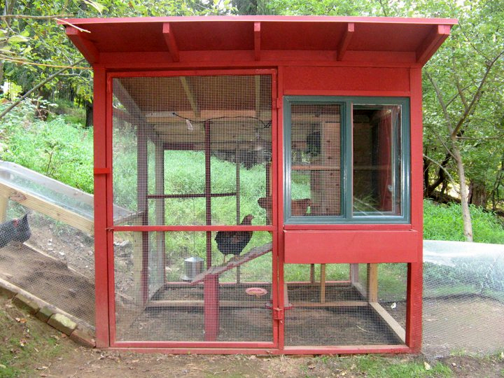 The main house uses new and salvaged lumberyard materials, including an inexpensive sliding window from Lowe's. There's a planting box under the window. The sleeping area is completely insulated with rigid foam sheathing. For cold nights there is a heat l