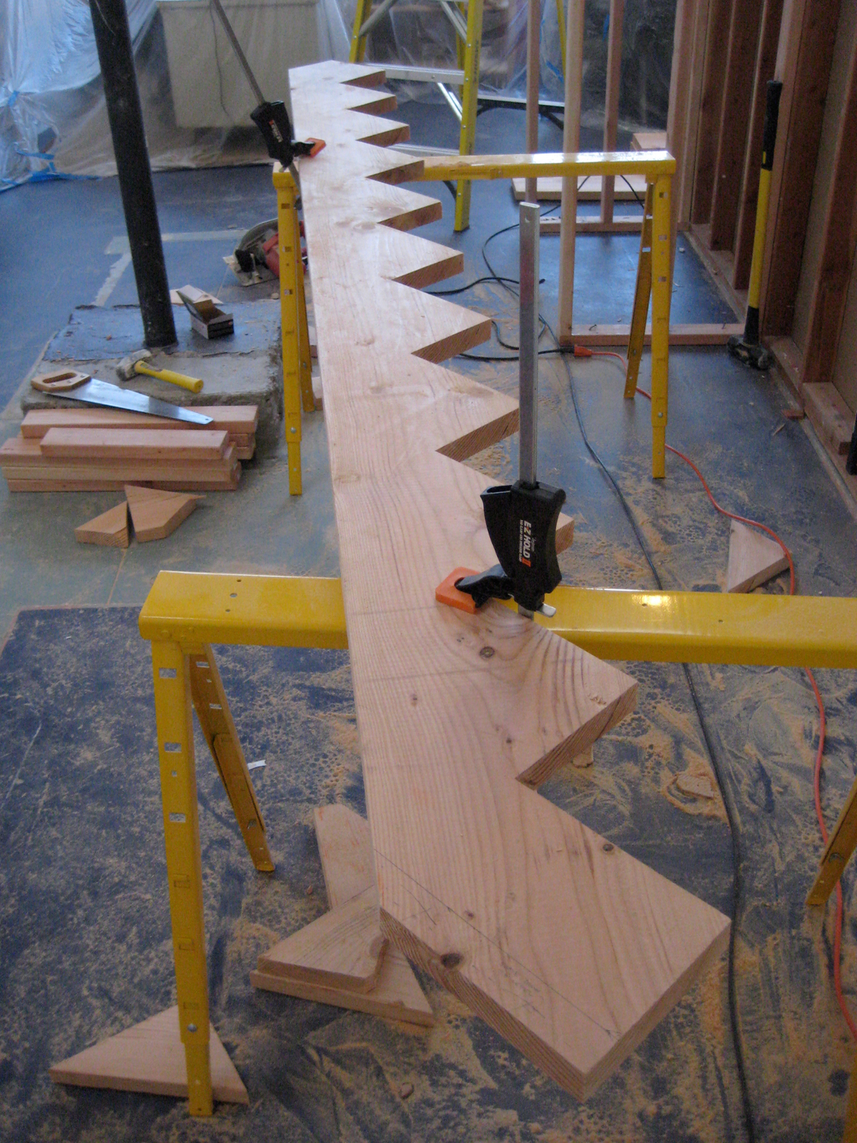 I had a mandate from Lynda—as soon as I demolished the existing stair I had to make a new one within 48 hours, because she didn't want to climb a ladder to get to her clothes. I had never built stairs before, but I did learn how to frame when I worked wit