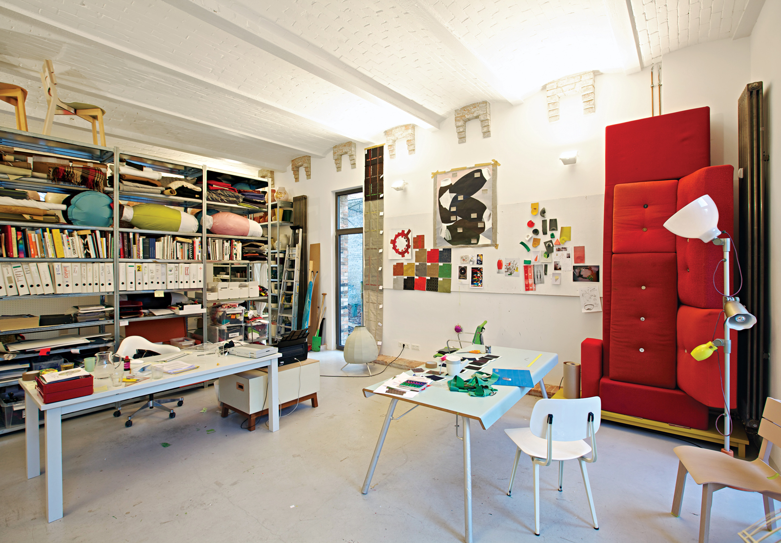 Jongerius's studio is a vibrant jumble of prototypes, products, and samples, including a red Polder sofa for Vitra and, on the far right, a Blossom lamp for Belux and prototype for the Rotterdam Chair for Vitra.