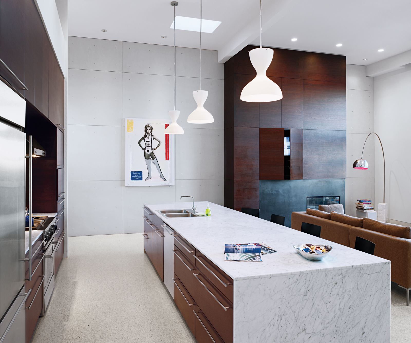When Nilus De Matran renovated this San Francisco kitchen ten years ago, he chose materials that would not only compliment and unify the open space—dark walnut, terrazzo flooring, and Carrara marble—but also materials that would stand the test of time.