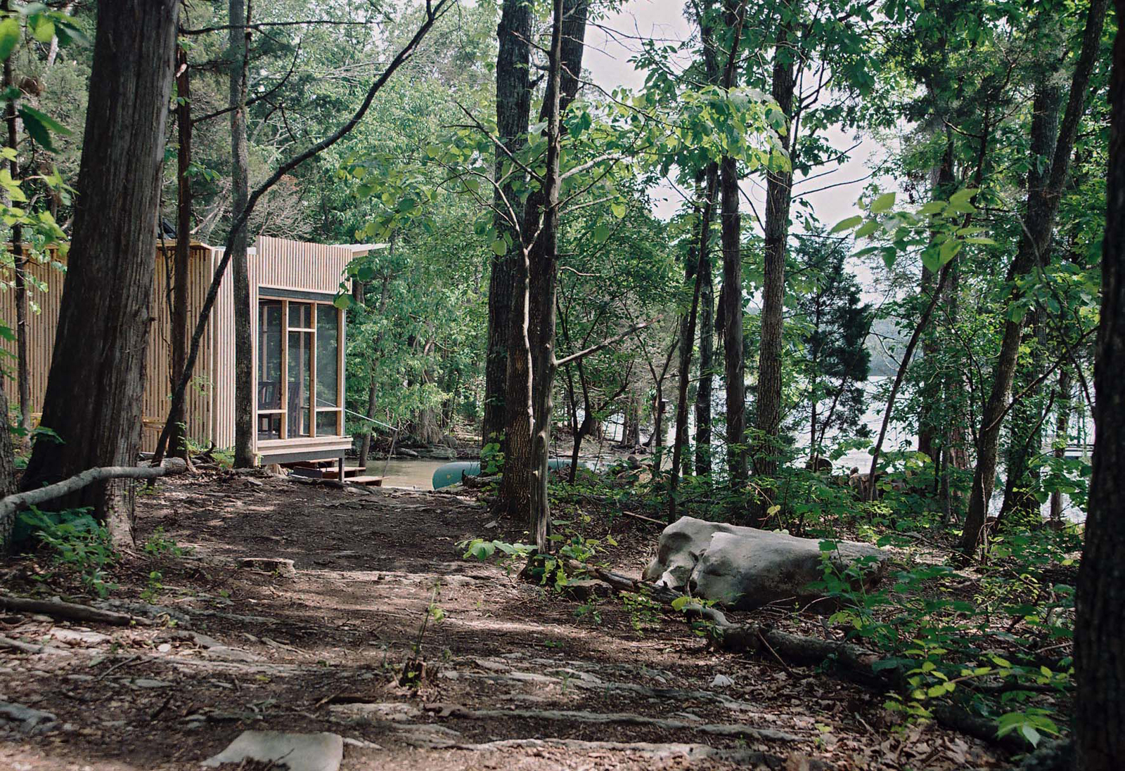 """Suzanne Shelton built a """"little cottage to get away to"""" on Tennessee's Norris Lake that's equipped with both rainwater-harvesting and solar-power systems for off-the-grid living."""