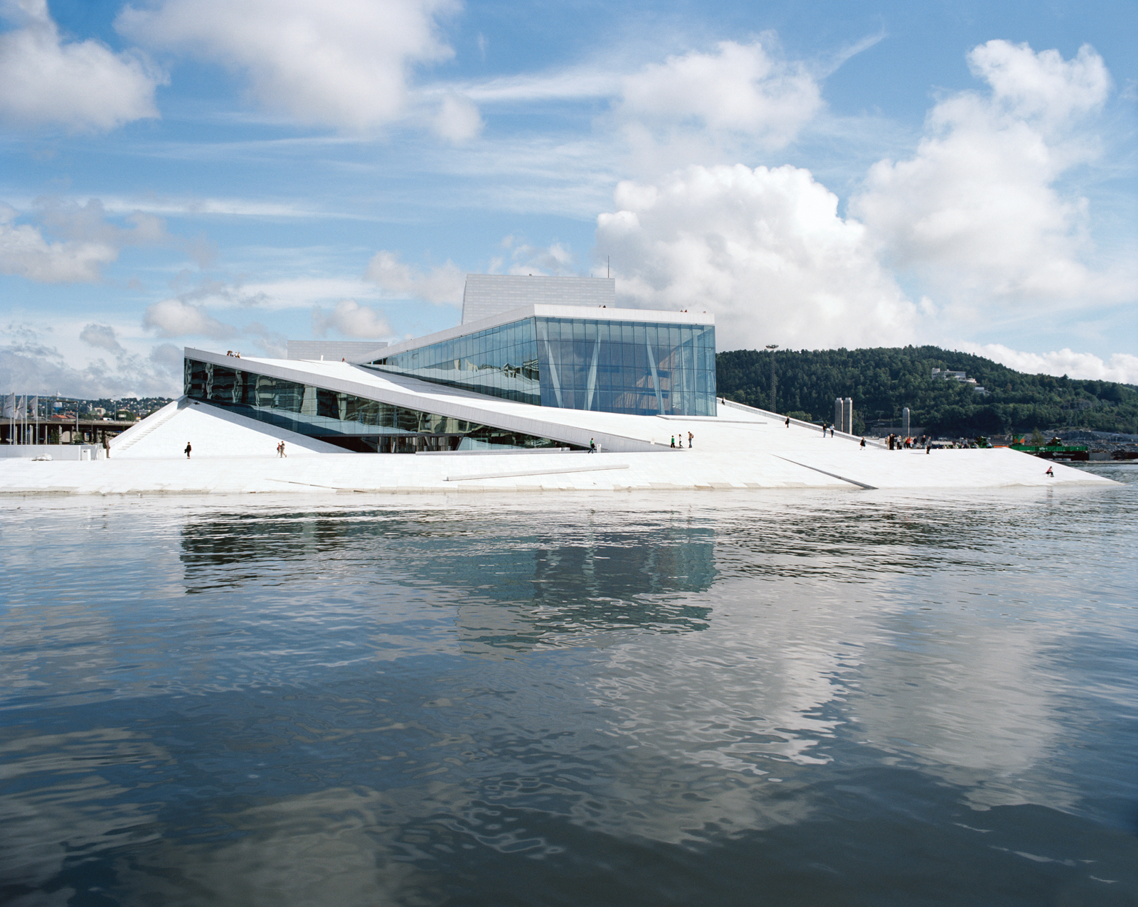 The 400,000-square-foot Norwegian National Opera and Ballet, designed by the Oslo- and New York–based firm Snøhetta, features a plaza and roofscape conceived as a single glacierlike object entirely available to the public—–embracing what architect Tarald