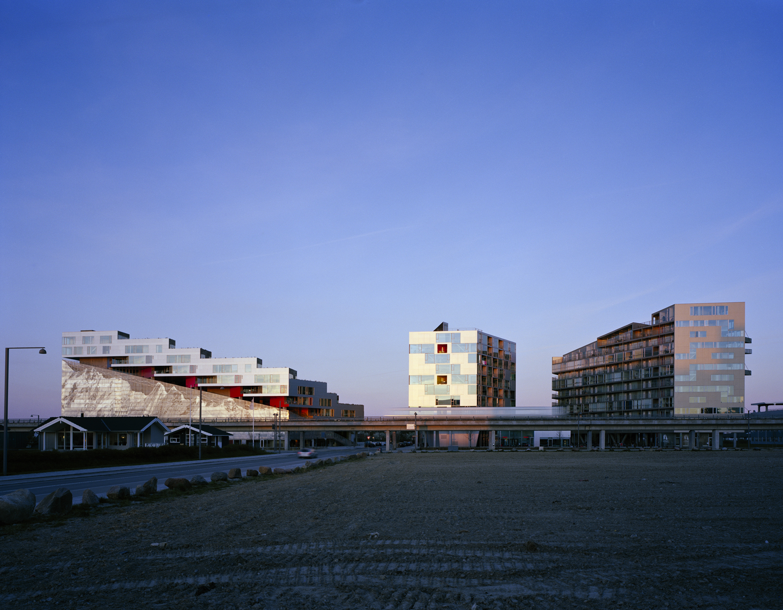 The VM Houses (the two buildings on the right) opened in Ørestad in 2005, with the Mountain Dwellings (left) following in 2008. Up next in the neighborhood: The firm's BIG House (or Figure Eight building) is scheduled to be completed in 2010.