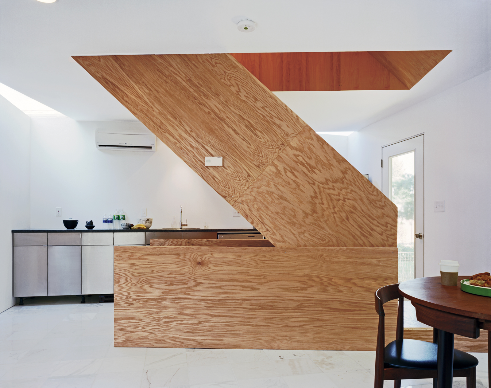 The wooden stairwell in the center of X-Small provides a pivot point from which the rest of the house rotates. The floor is Carrara marble bought from Olympia Marble and Home Depot.