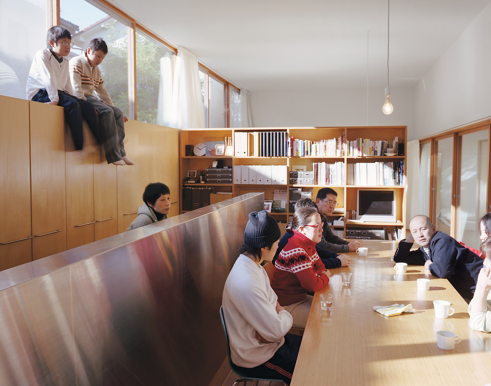 "Hidekazu Higashibata wanted to recreate the same sort of feeling he'd experienced on trips to Italy—a long table, leisurely meals, and lengthy conversations. The boys discovered the home's ""second story"" on top of the cabinetry and, armed with a ladder, l"
