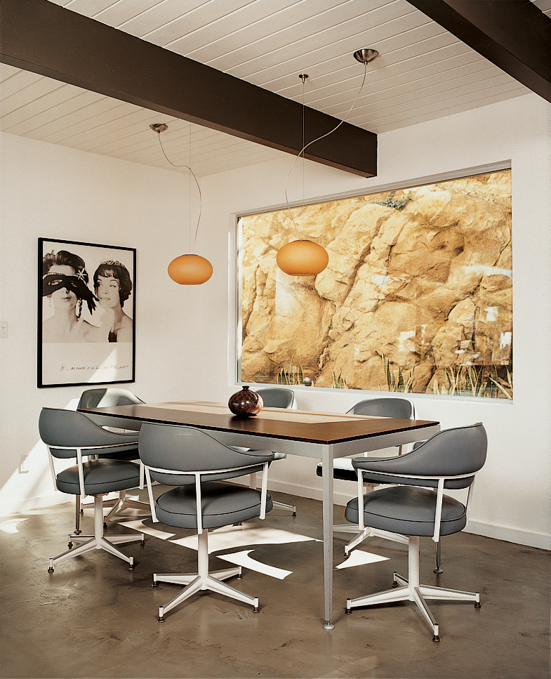 The dining room. Much of the furniture was purchased from vintage modern home stores in L.A. The furnishings represent an attitude—whenever possible, recycle, reuse, and support local manufacturers—as well as a strong sense of aesthetics at home.