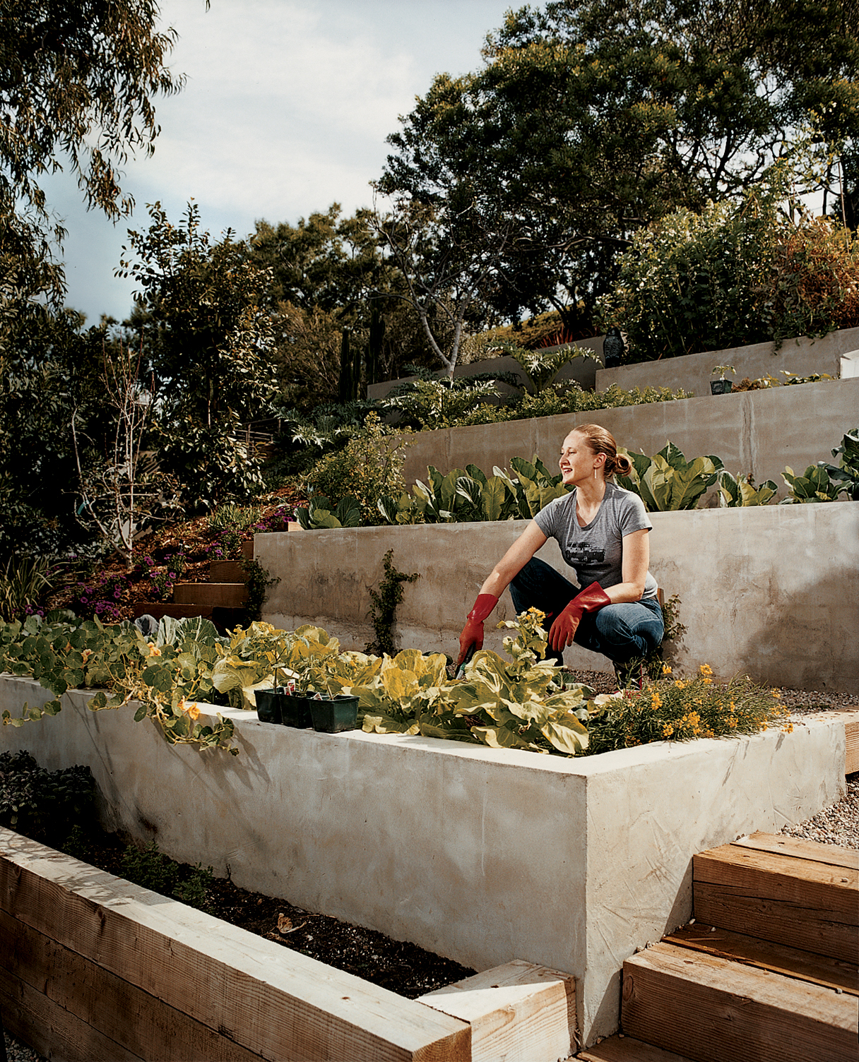 Wakeland goes to work on the garden terraces where the couple grows much of their own food.