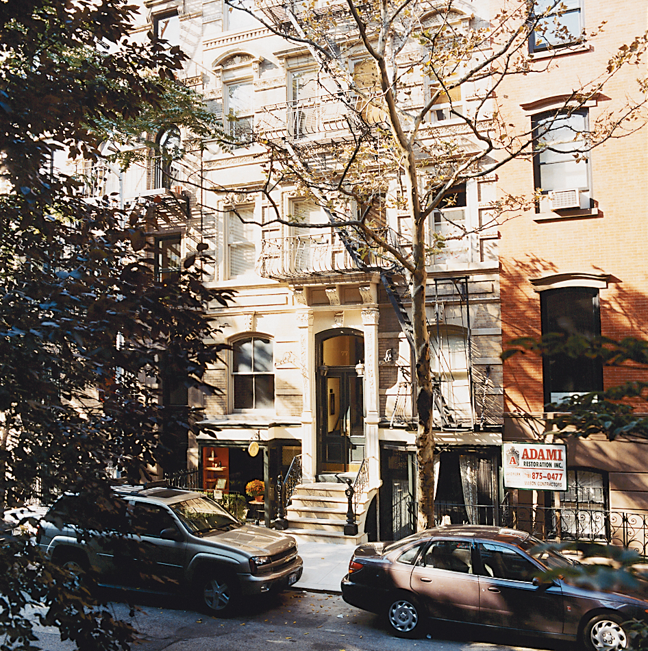 Milan Hughston's apartment is at the rear of a historic multi-unit building