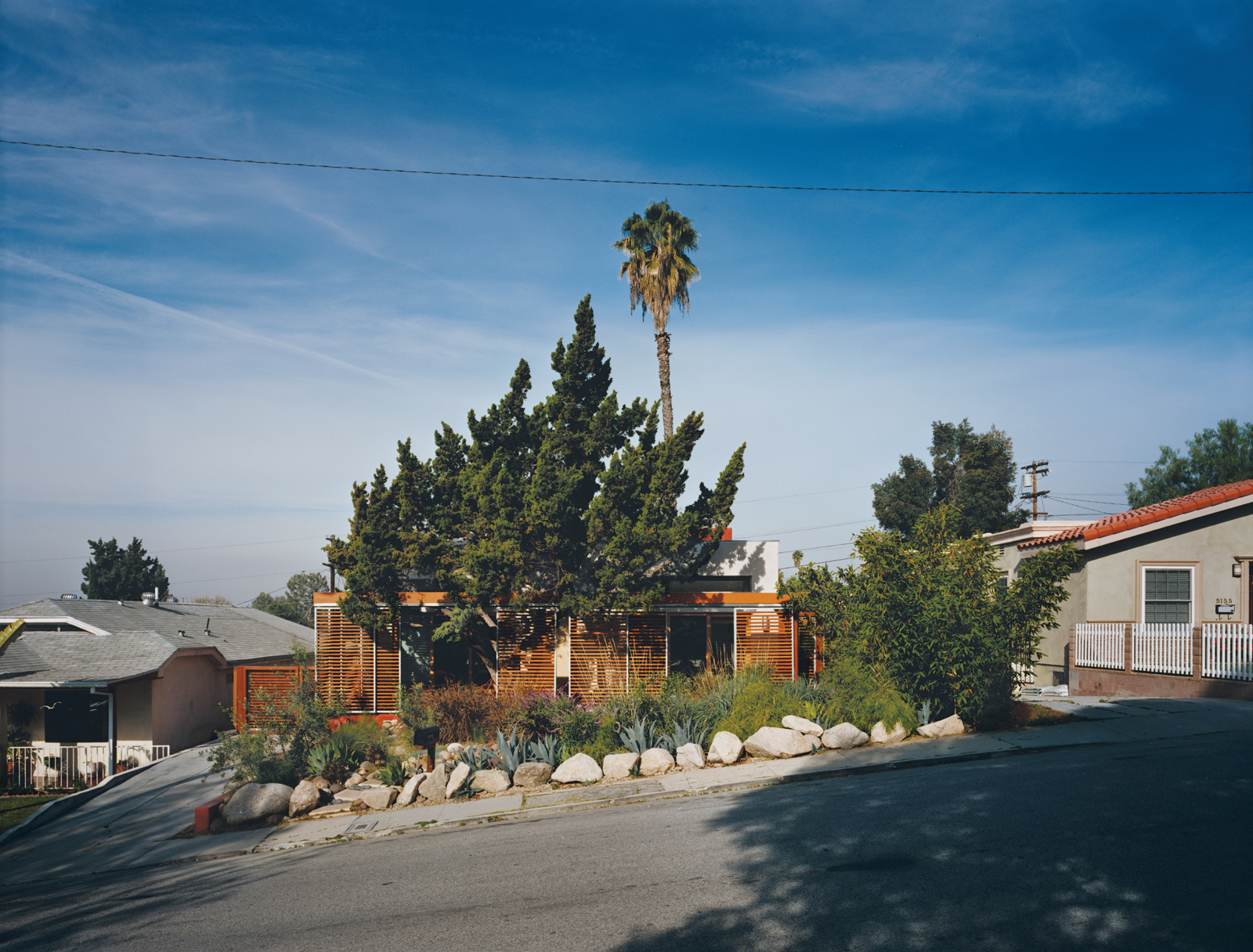 When Jeremy and Robin Levine remodeled their house in the Eagle Rock district of Los Angeles, they chose to keep it at the scale, if not the style, of other houses in the neighborhood. They expanded it back and front by building shady decks around existin
