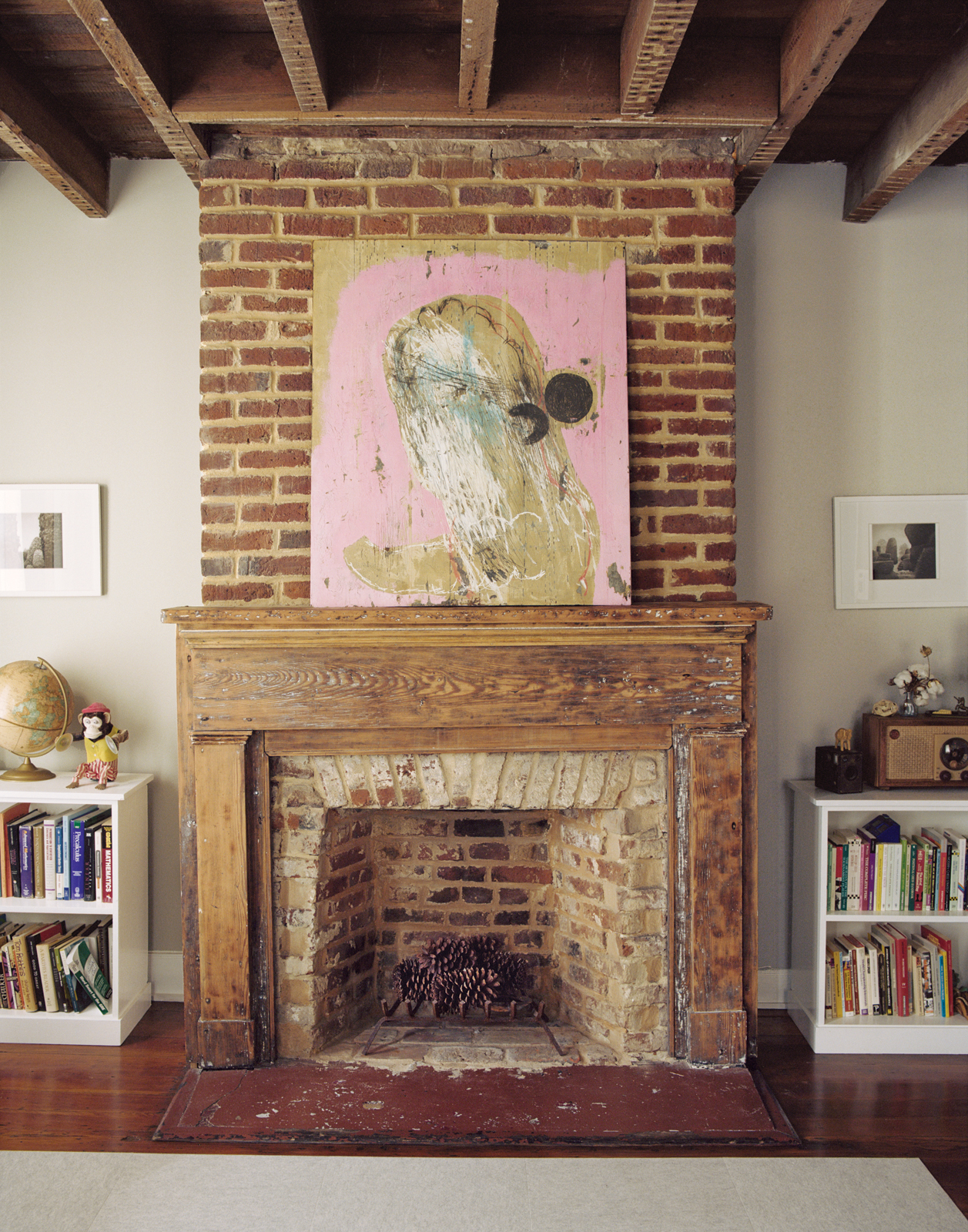 One of six fireplaces in the Rice and Nissenboim residence, this one featuring a large painting.