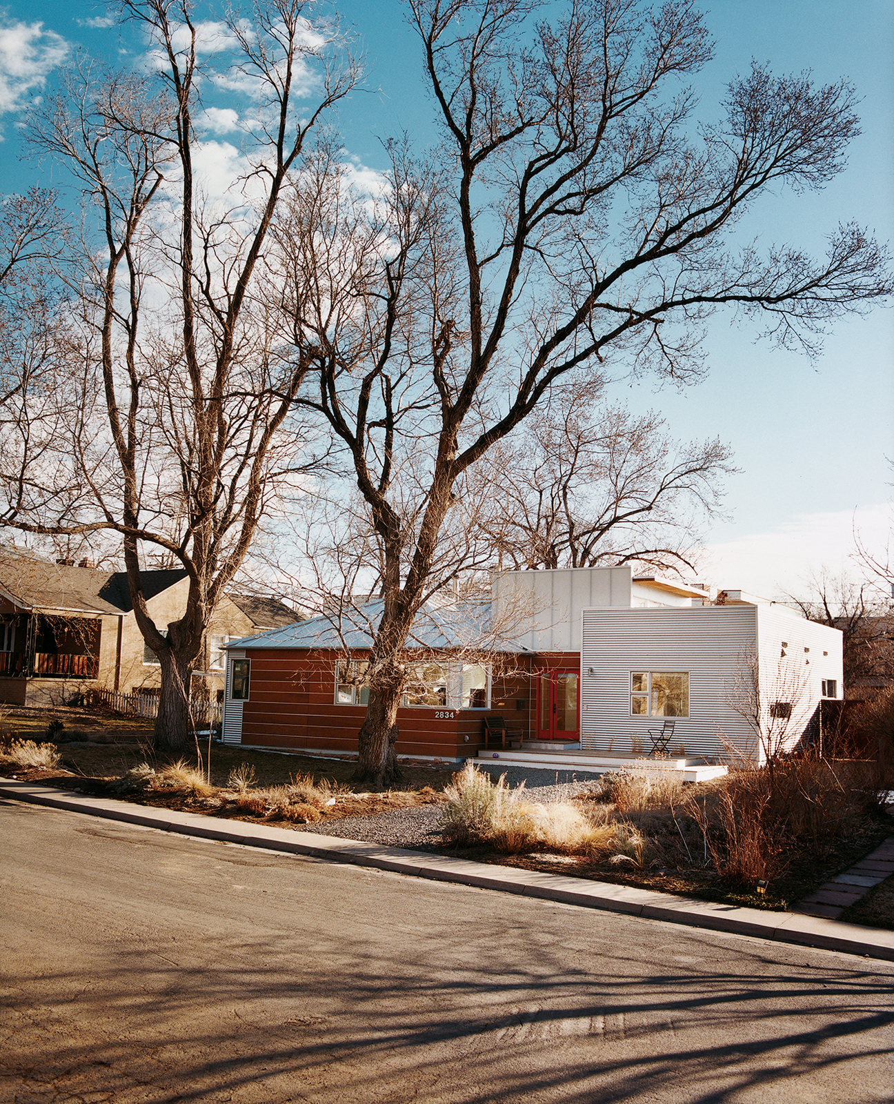 Architect Rob Pyatt's box-shaped addition is the modern kid on the block, with distinctive corrugated-metal and wide-plank cladding. Behind the facade, uncommon materials share a common story with the neighborhood: Of design decisions driven by a desire t