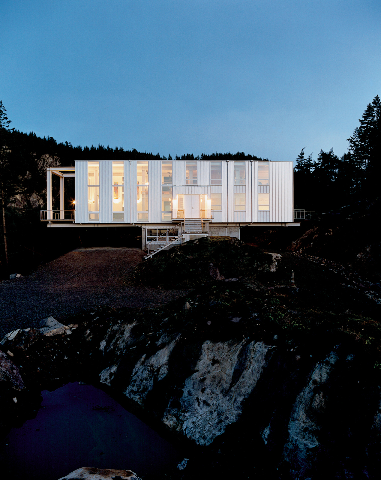 Looking like a jewel box at dusk, Scott Stafne's Cantilever House rests easy in the middle of the Washington woods. With miles of hiking trails, lakes, and waterfalls to explore, Stafne's property provides almost unlimited opportunity for outdoor adventur