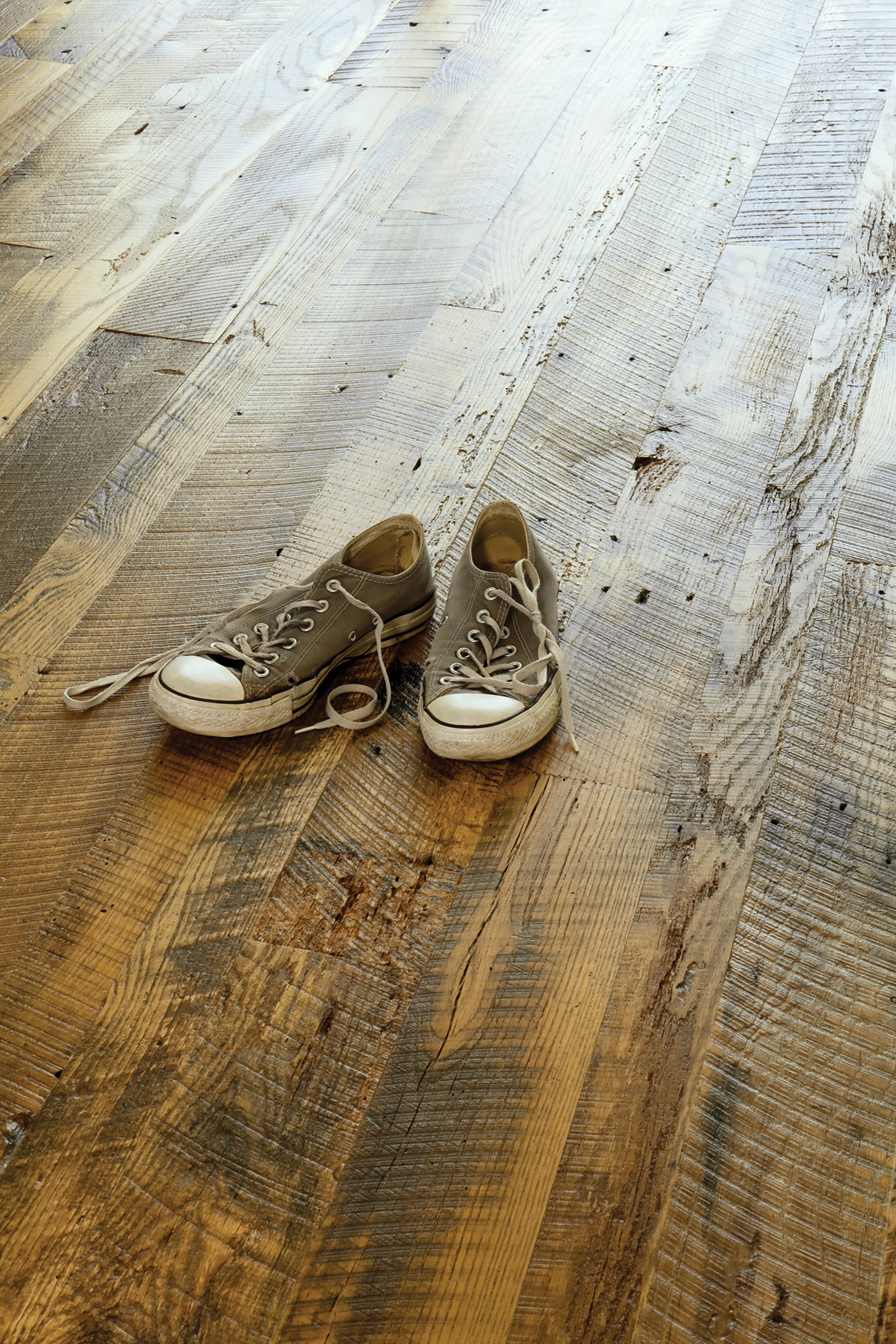 The wood floor of the Suttles and Shag residence reclaimed from a barn in Missouri.