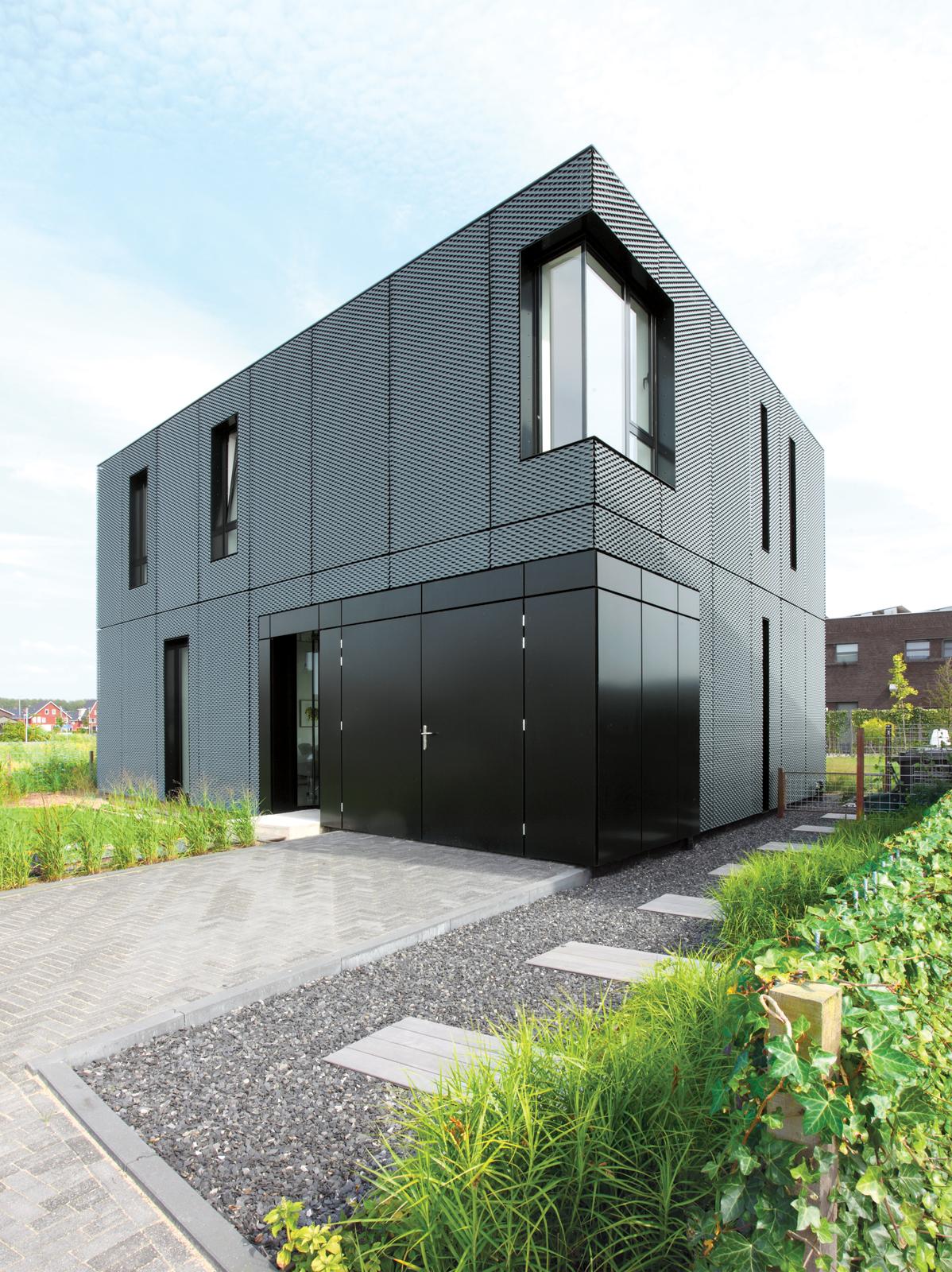 Dark grey metal house Villa DVT The Netherlands by BoetzkesHelder