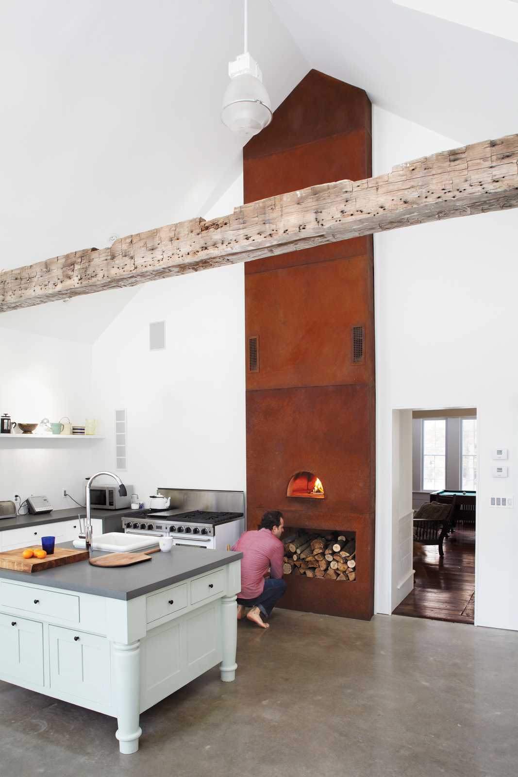 floating farmhouse kitchen pitched roof wood-fired oven