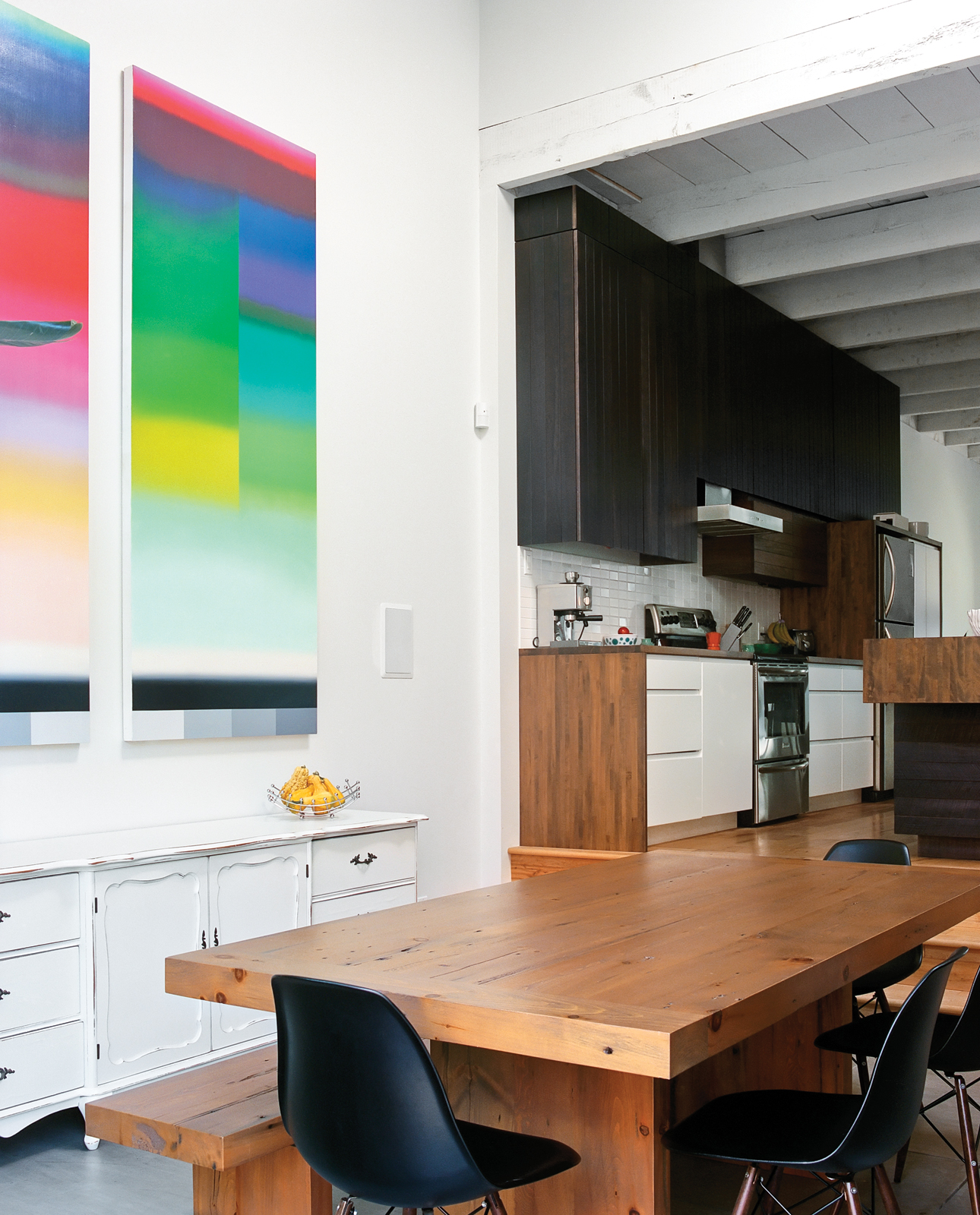Minimalist dining area kitchen with colorful wall art