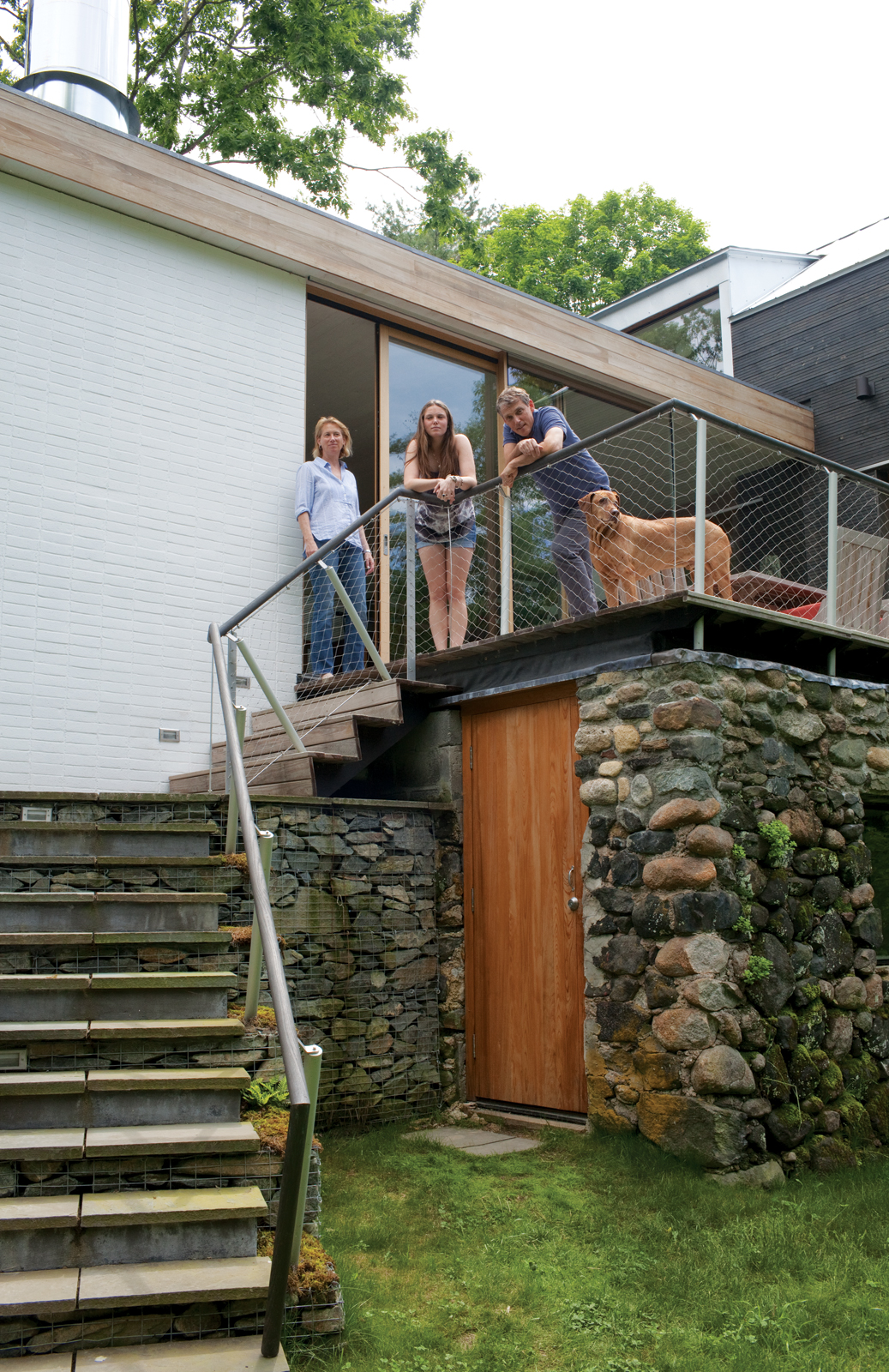 Modern outdoor staircase area with gabion walls