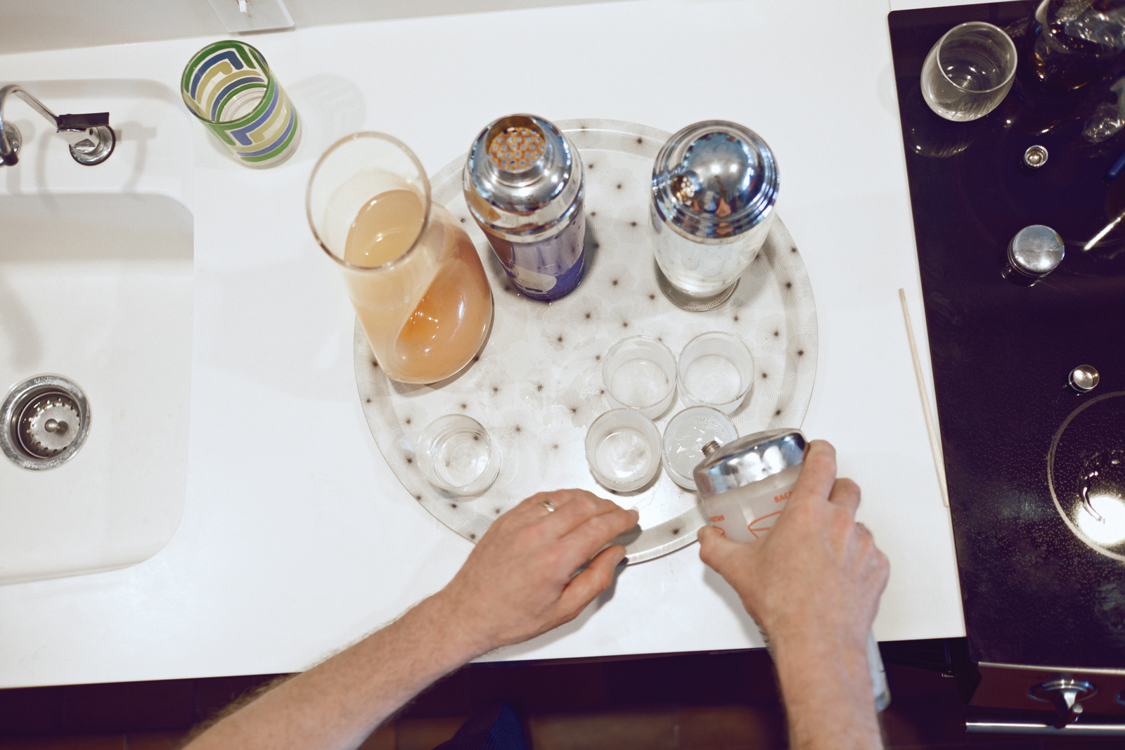 Host preparing cocktails