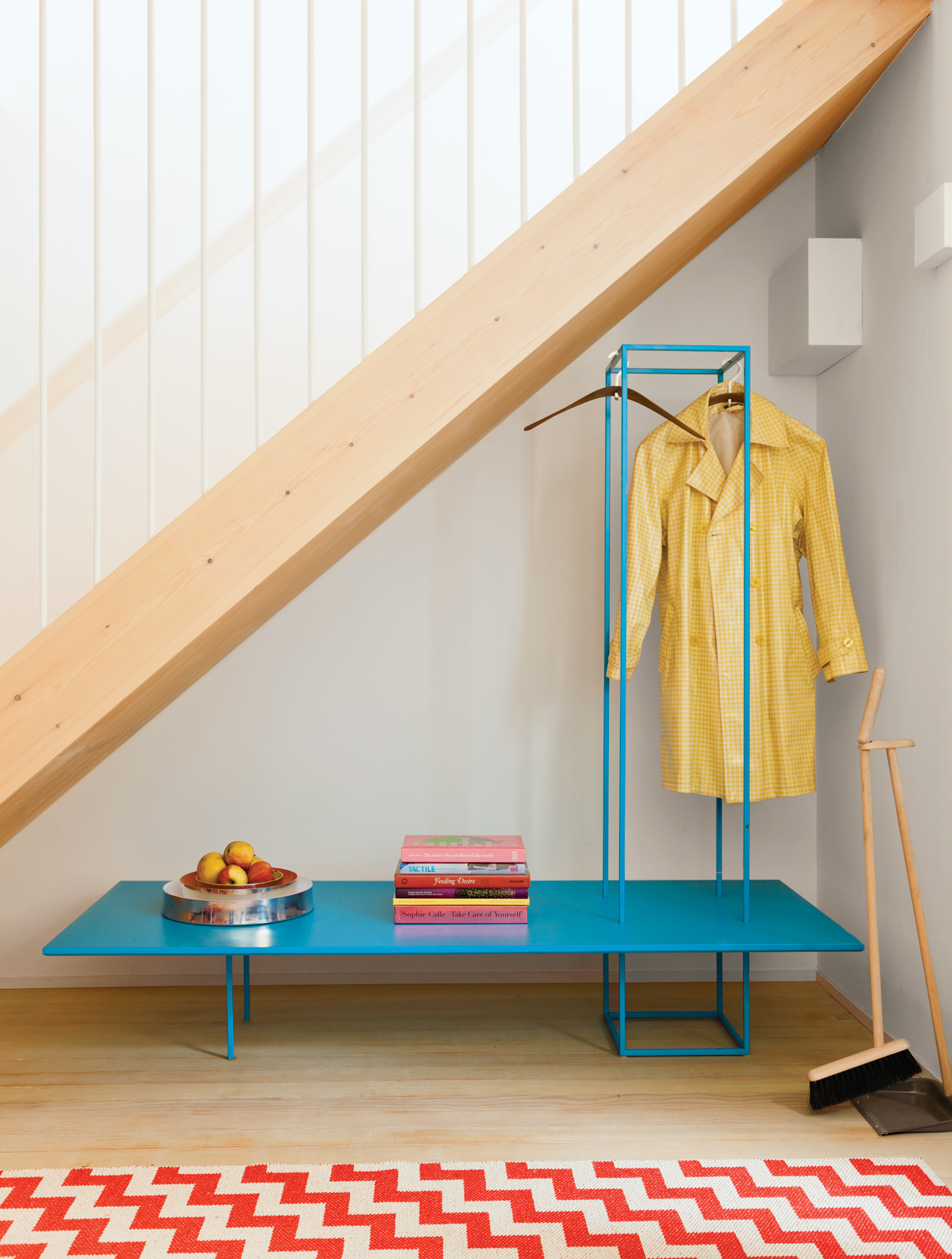 Geometric bright blue clothes rack bench