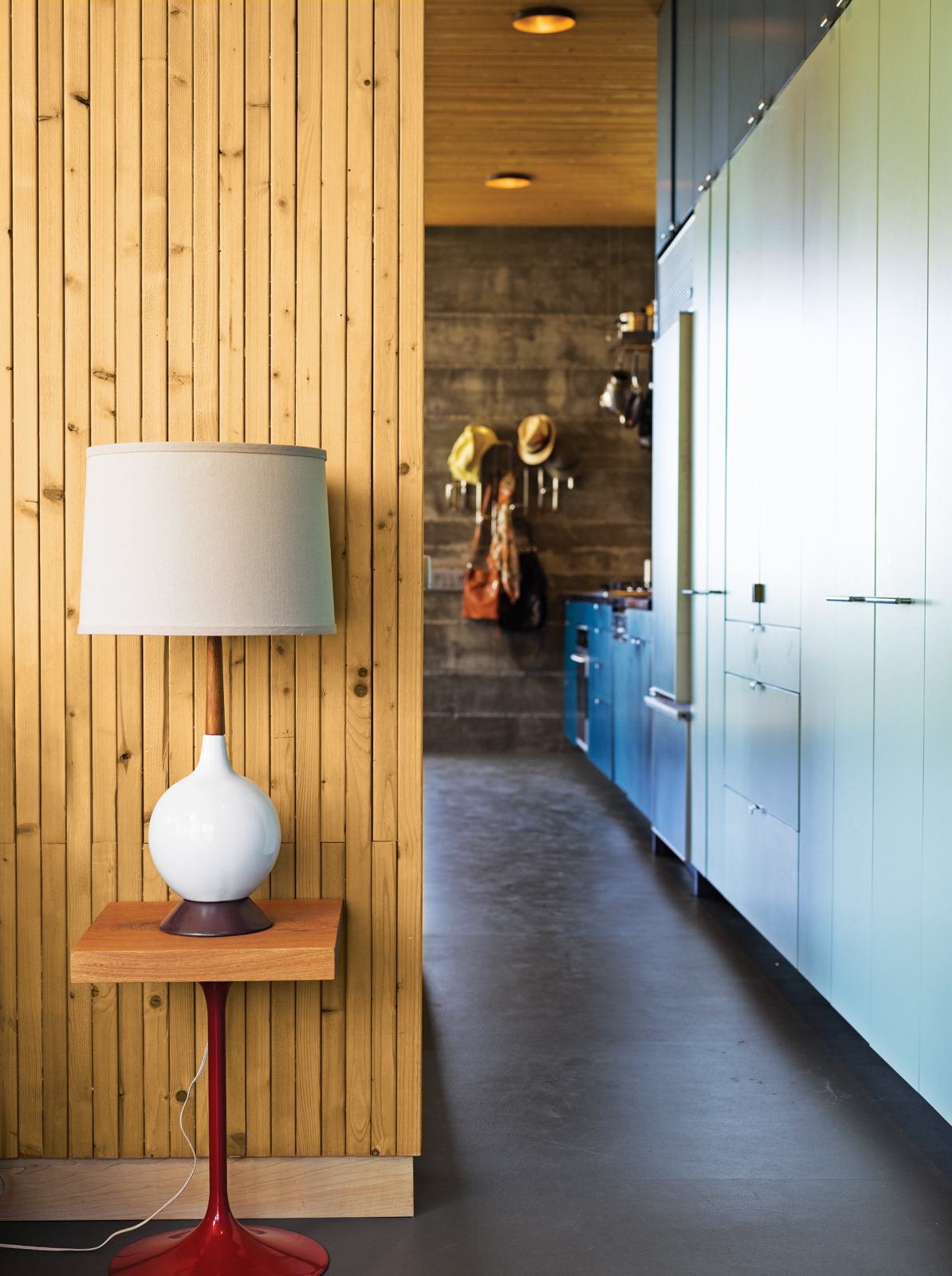 Modern kitchen hallway with wood-paneled wall