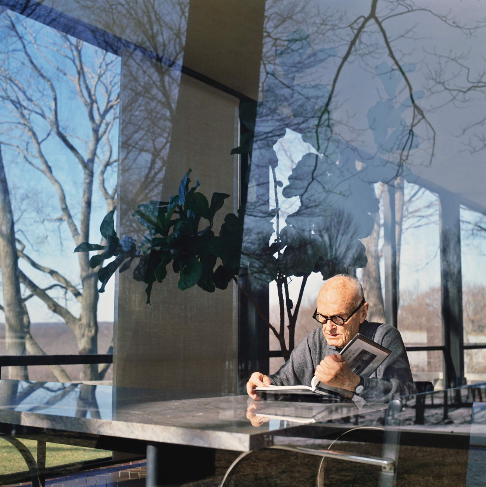 Architect Philip Johnson reading a book