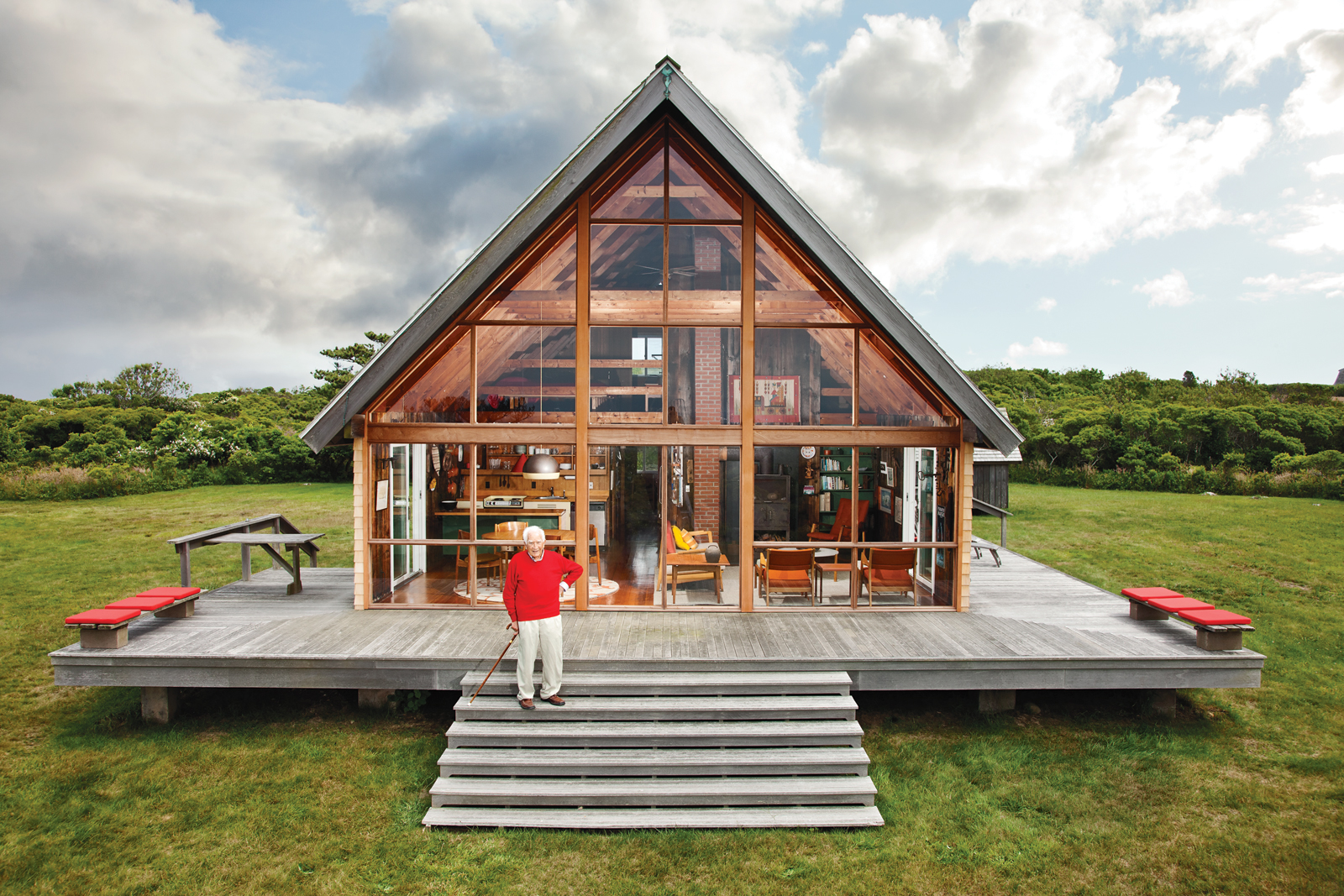 Designer Jens Risom in front of his vacation home on Block Island