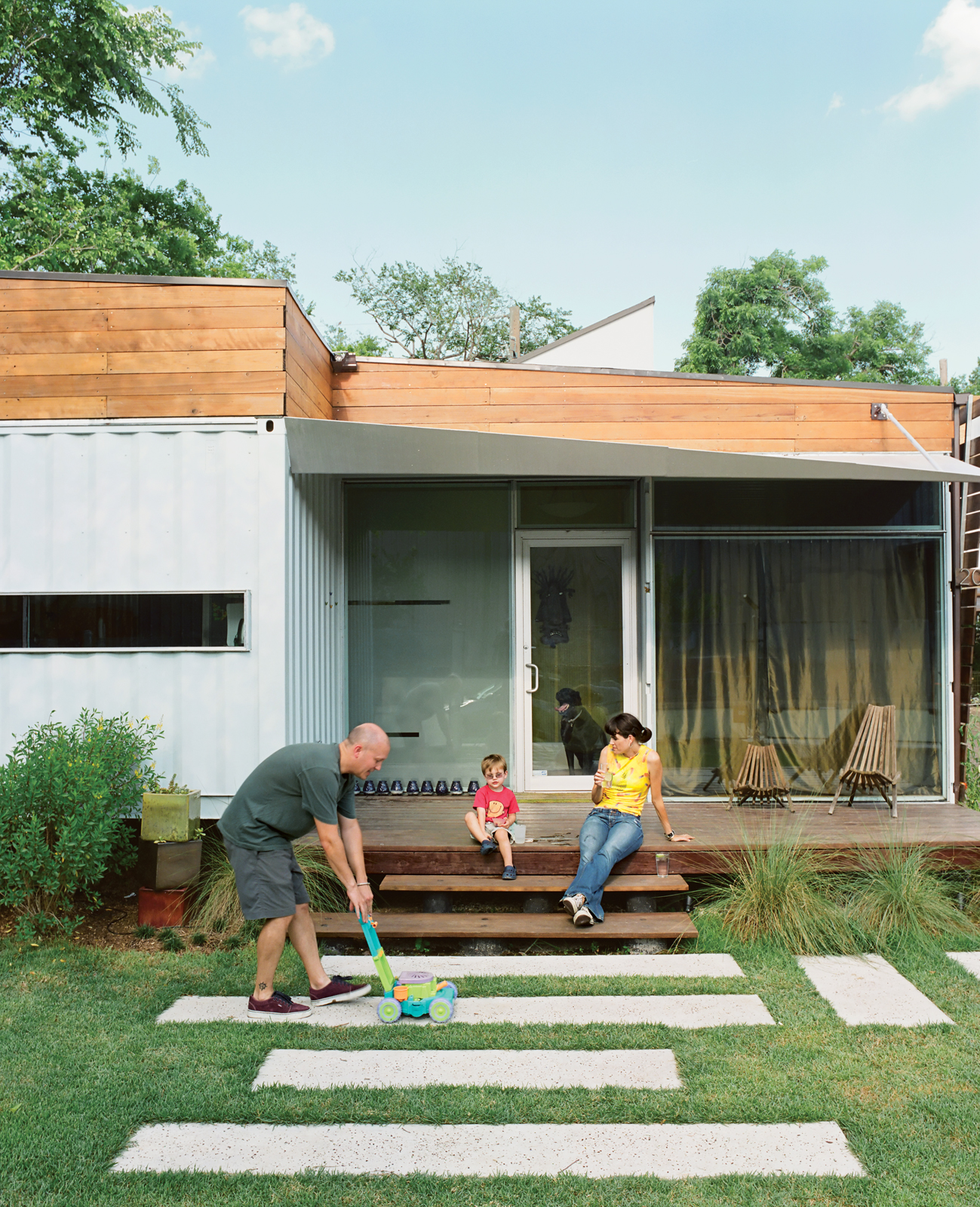 "One of the main draws of Kevin Freeman and Jen Feldmann's house is its connection to the neighborhood, which is why the front porch was a must. ""Homes that have a door but no outside space say, 'I'm not interested in you,'"" designer <a href=""http://robdes"