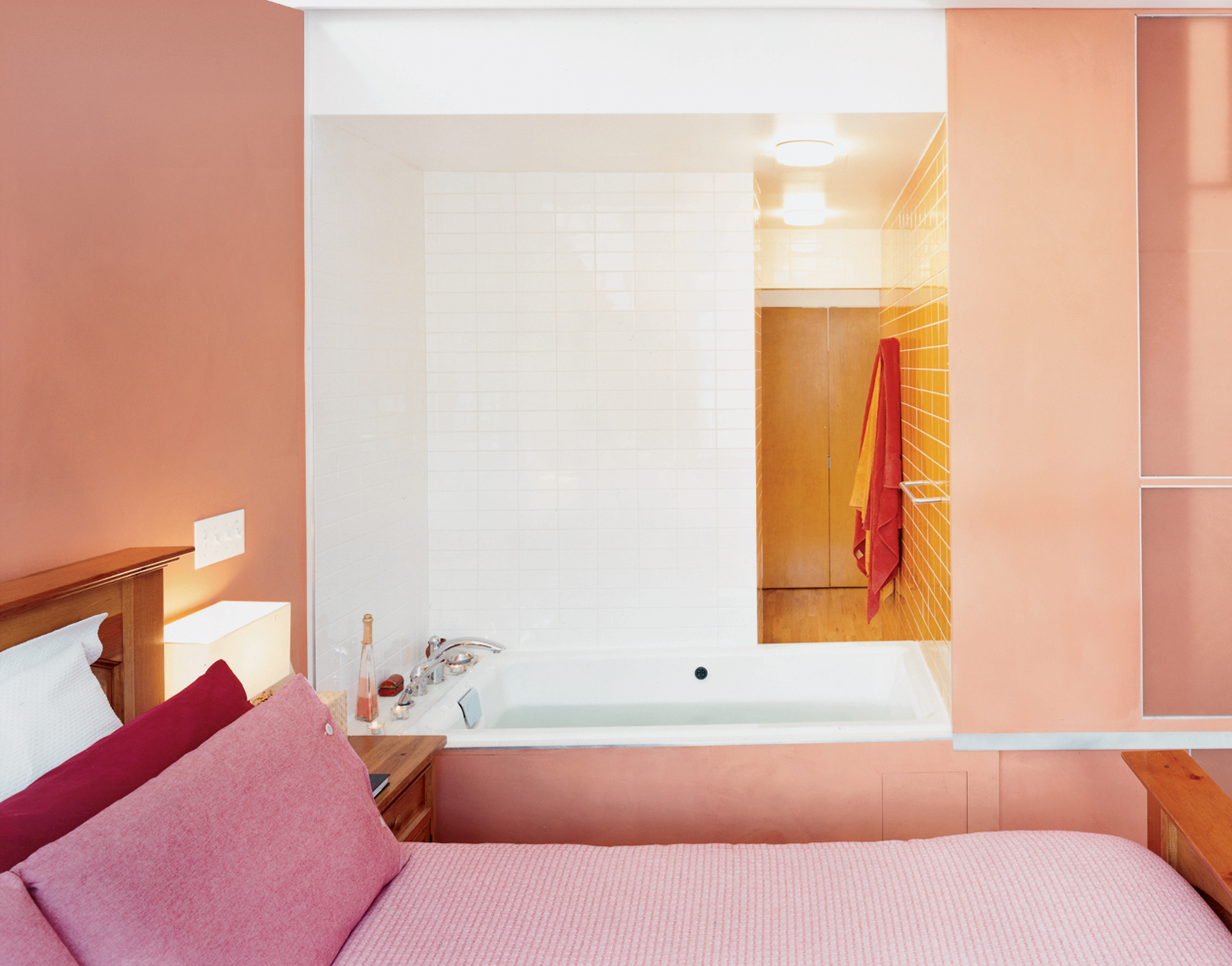 Pink master bedroom with hot tub