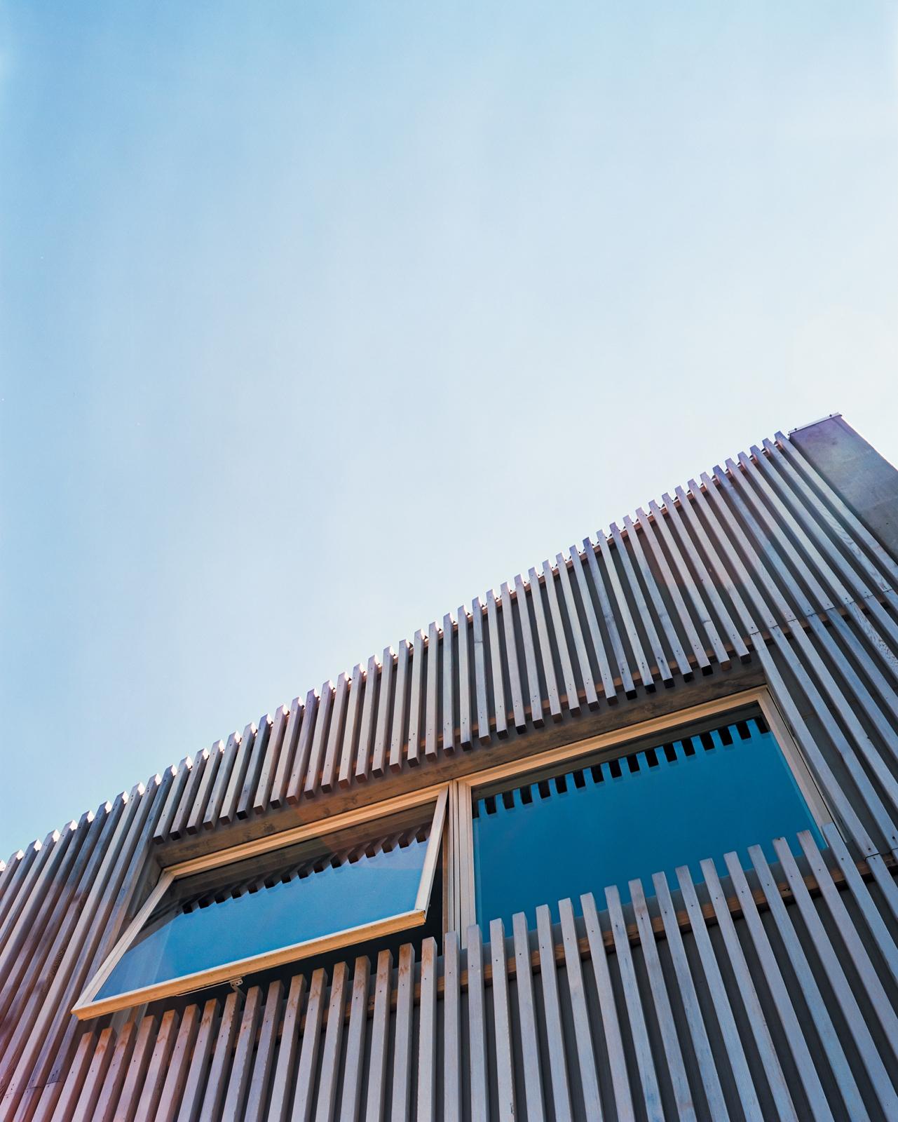 Modern home facade with cedar-slat rain screen