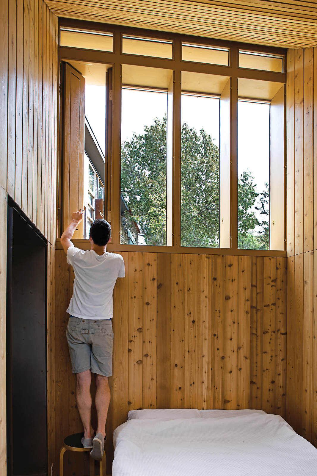 Modern bedroom clad in wood
