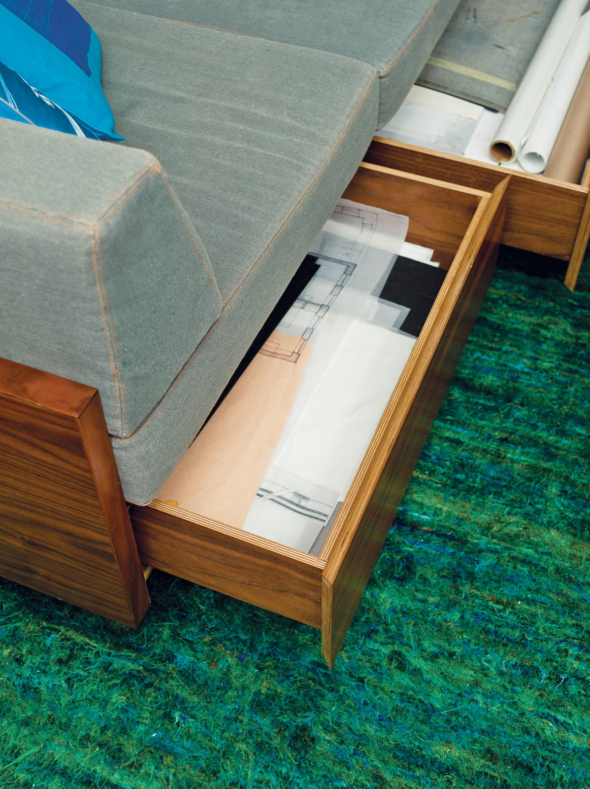 Built-in storage drawers in sofa
