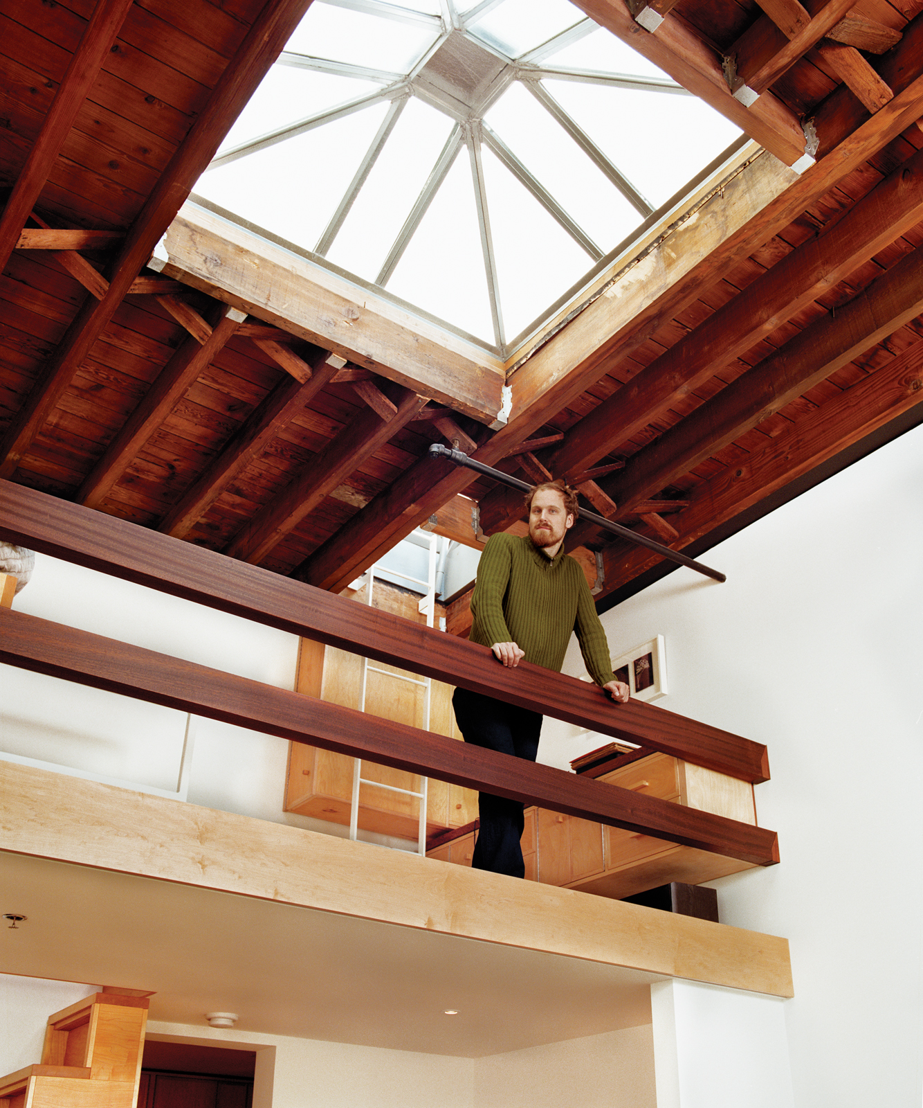 Upstairs sleeping loft with mahogany rails
