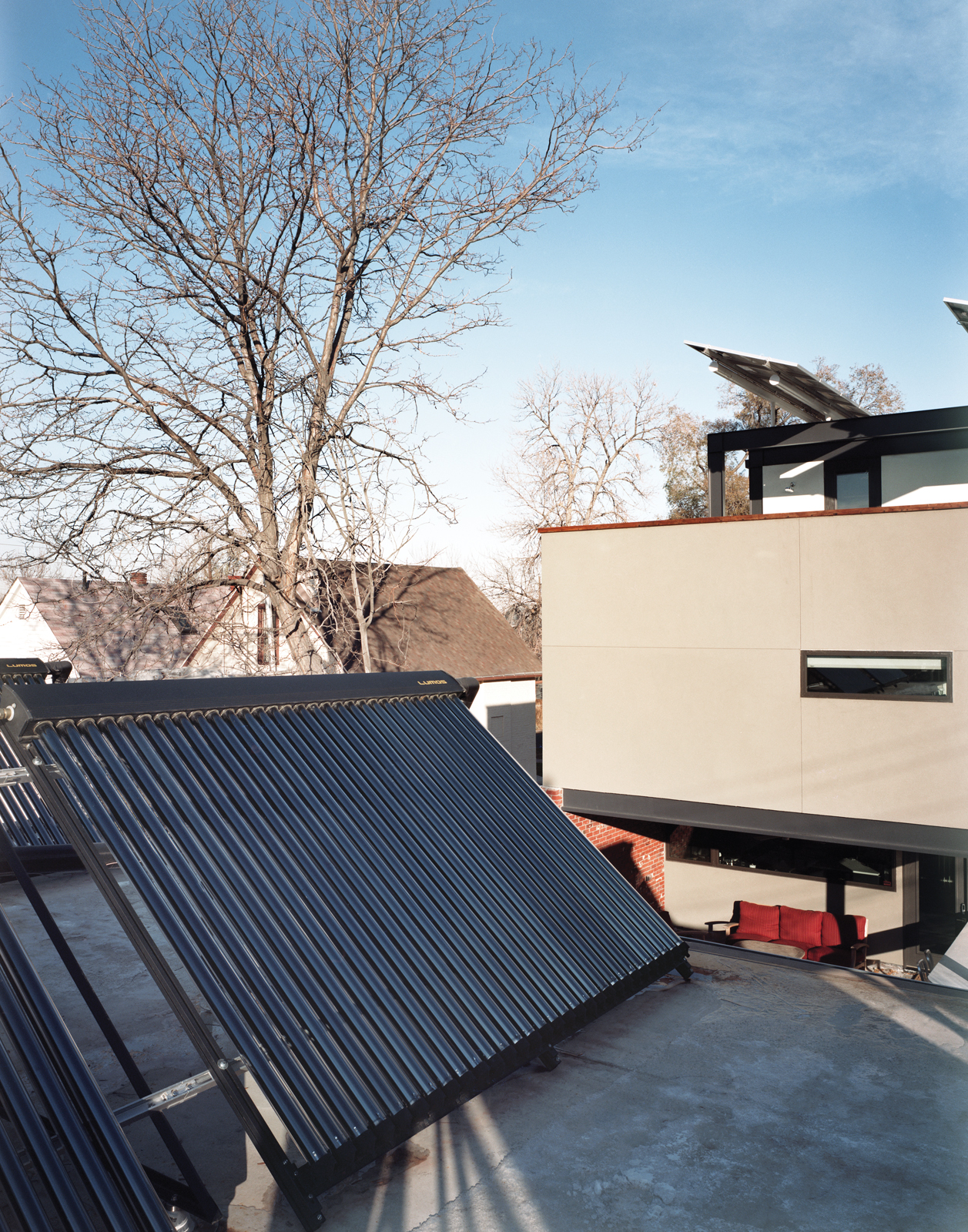 Garage with solar thermal tubes and photovoltaic panels
