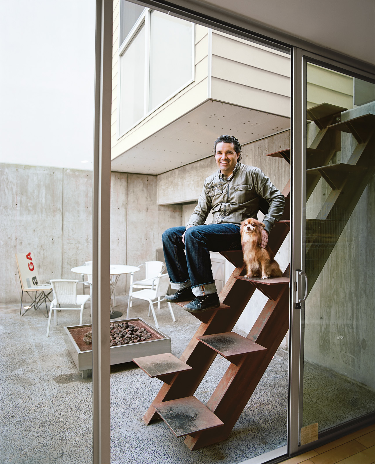 Architect Jorge Gracia sitting on outside custom-made Cor-Ten staircase