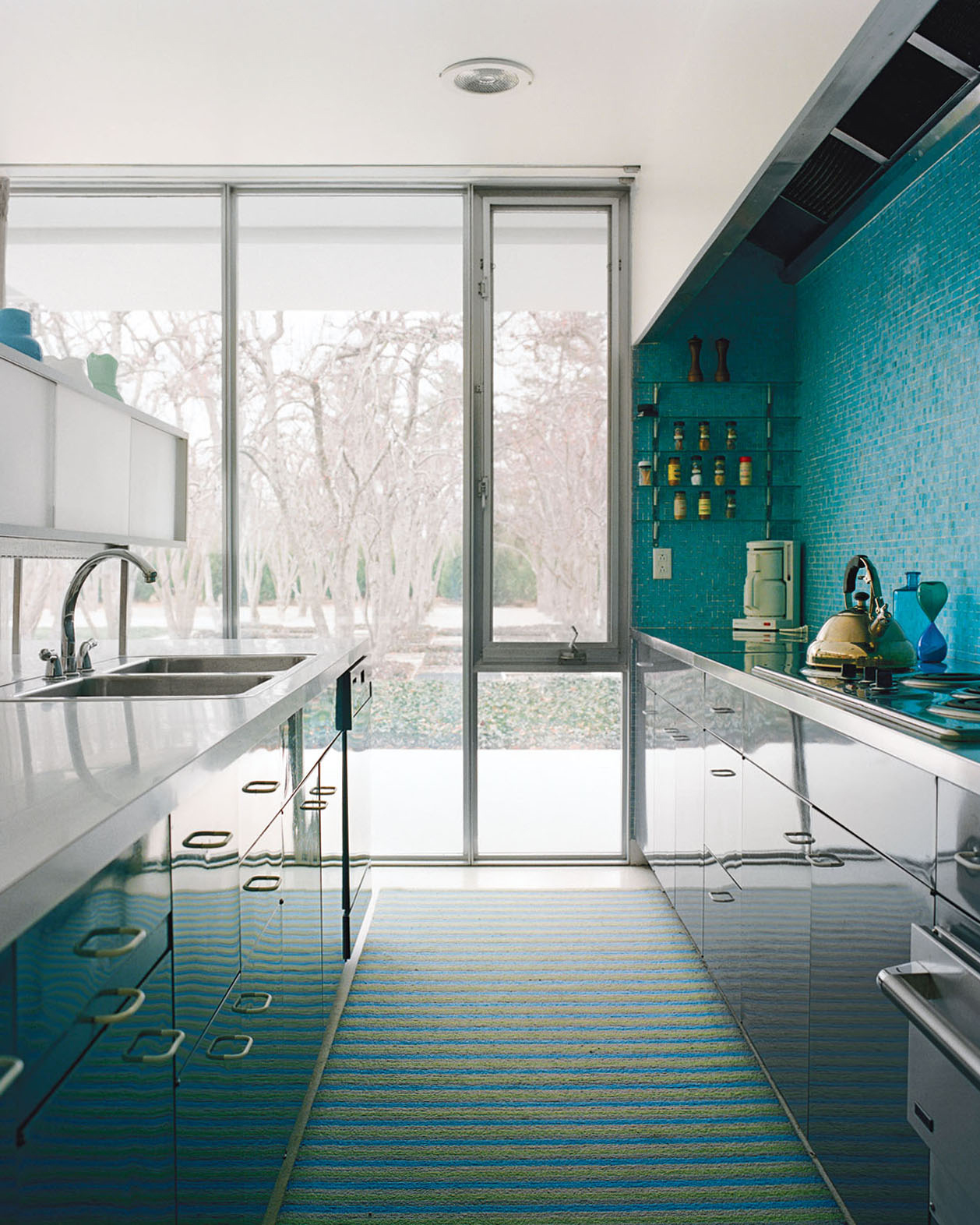 Miller House kitchen with a turquoise blue mosaic tile wall