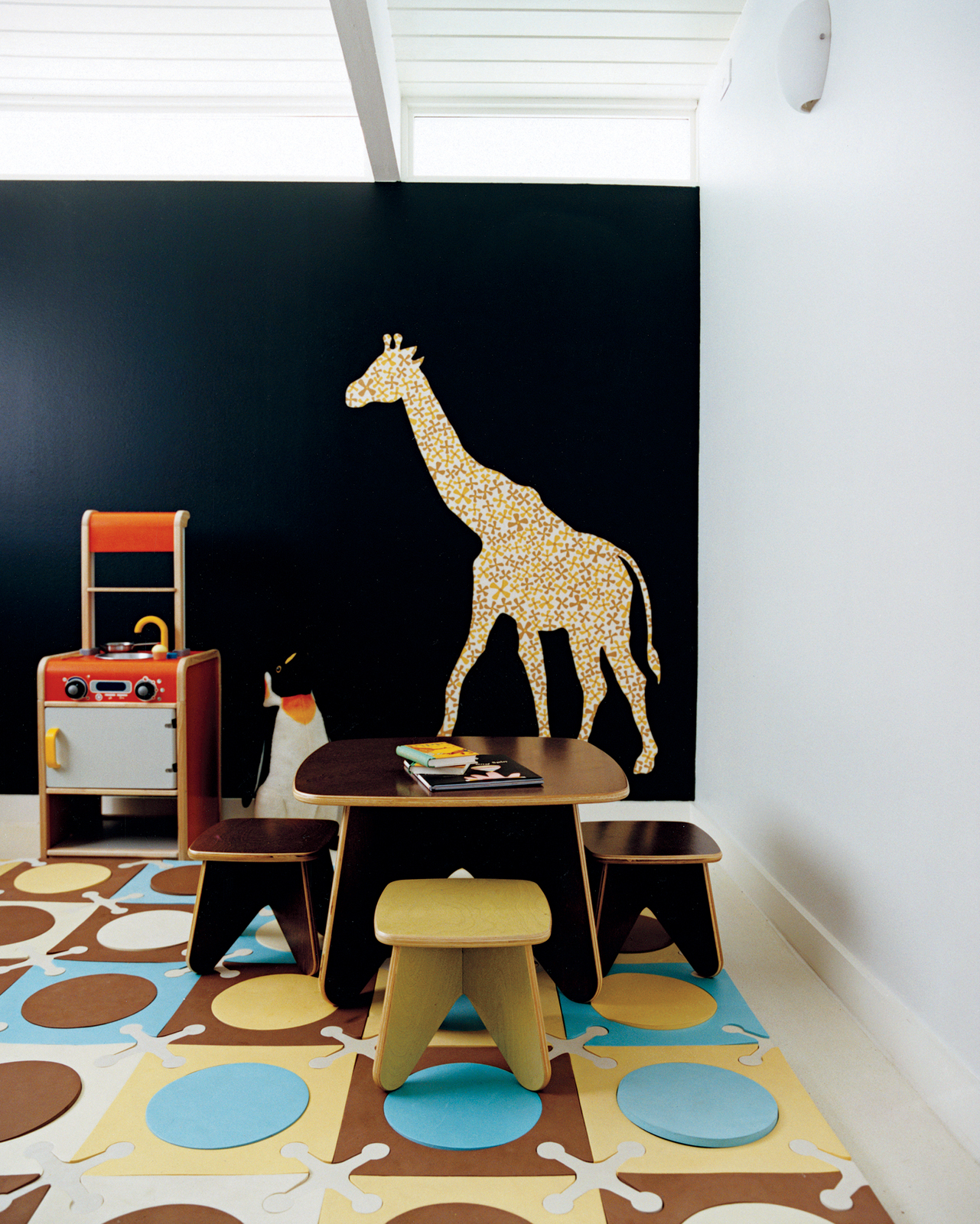 Jennifer and Mattias Segerholt selected a deeply saturated blue hue color for the playroom wall inside their Portland, Oregon, home. All the interior walls are painted with matched hues from Le Corbusier's Polychromie Architecturale, a book that the pair