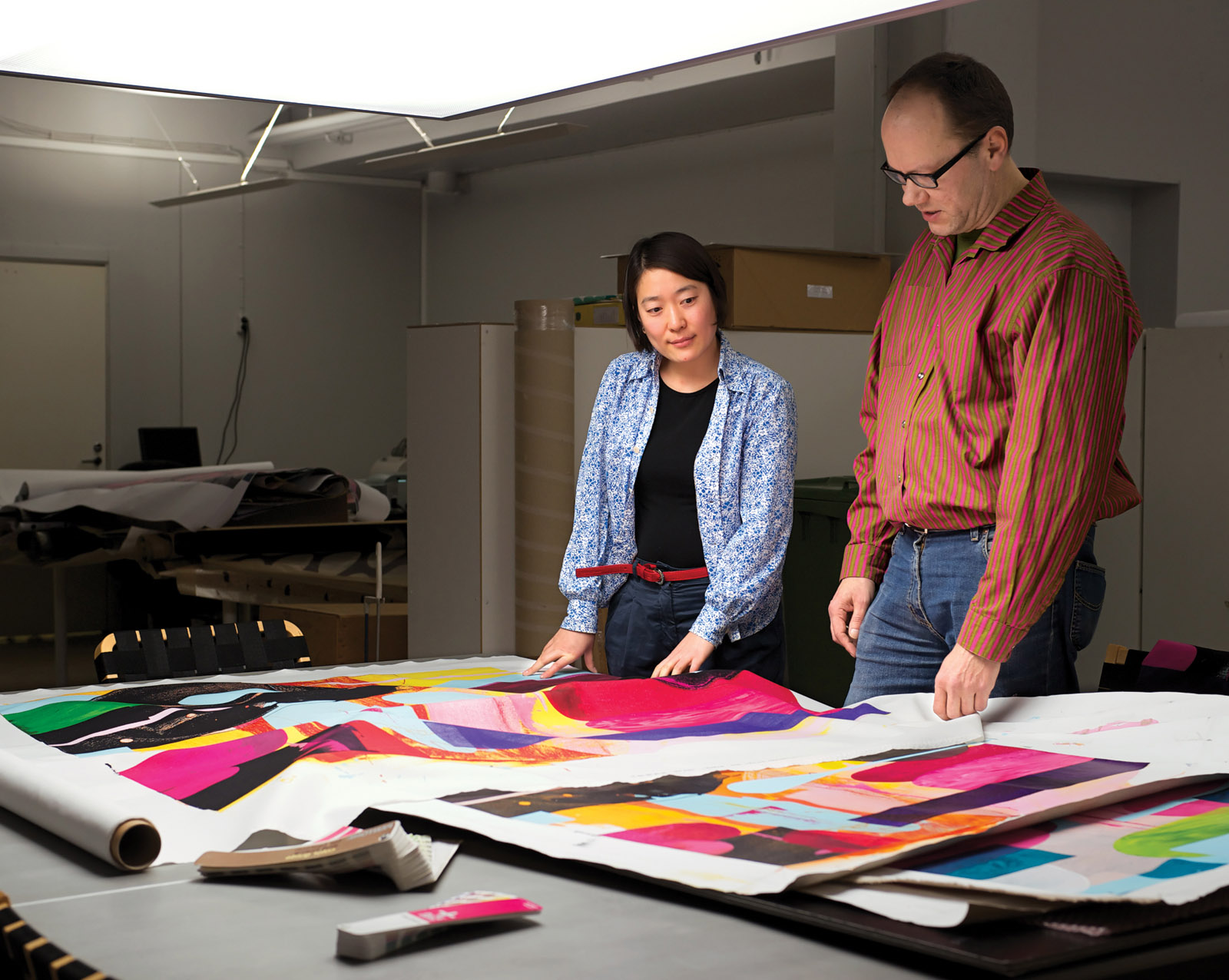 Design team comparing proofs at the Marimekko factory