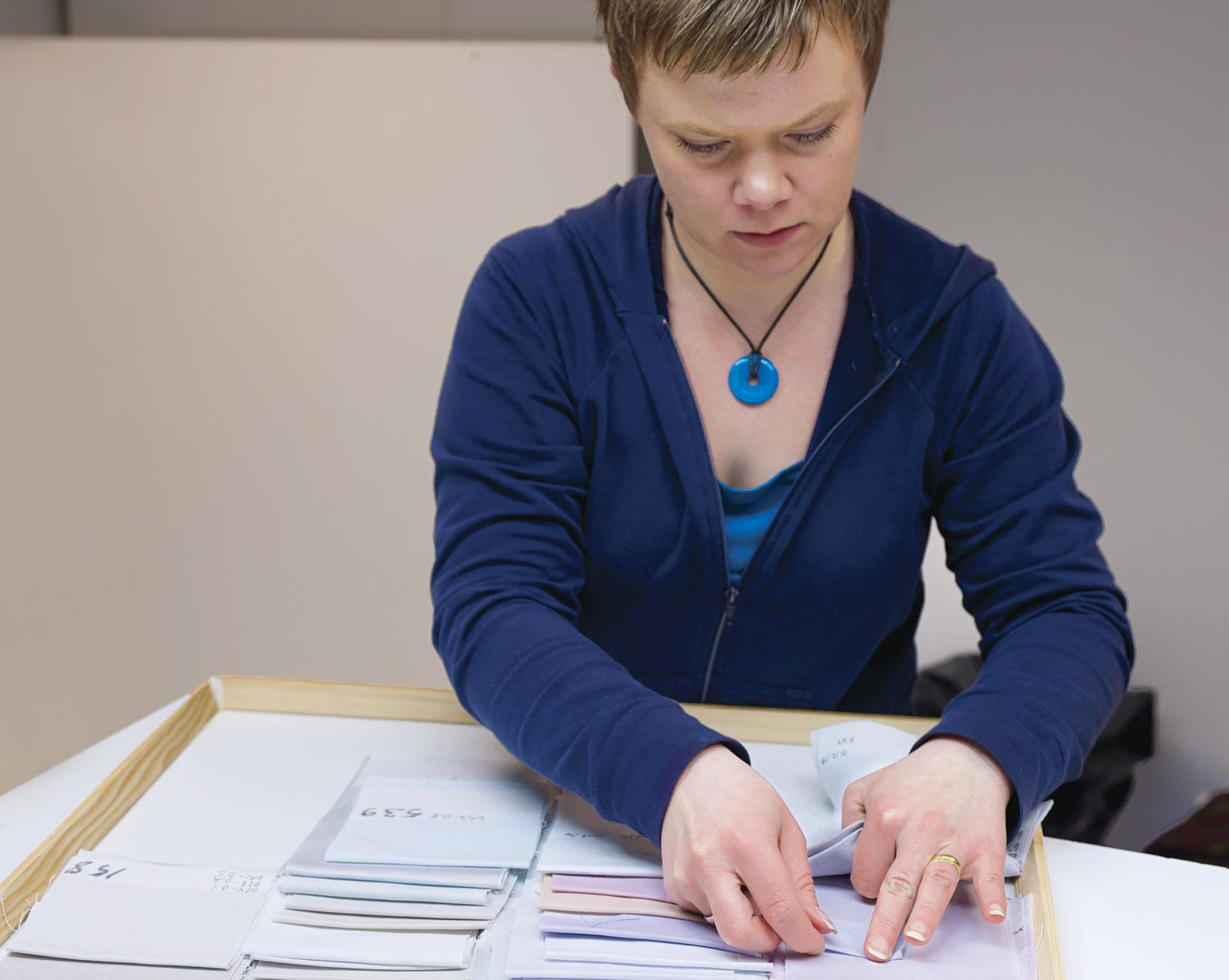 Taina Tiilikainen thumbing through Marimekko swatches