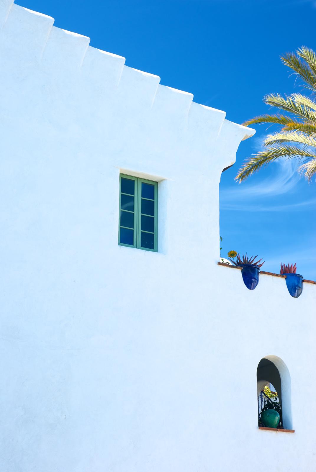 spanish rev all white facade side